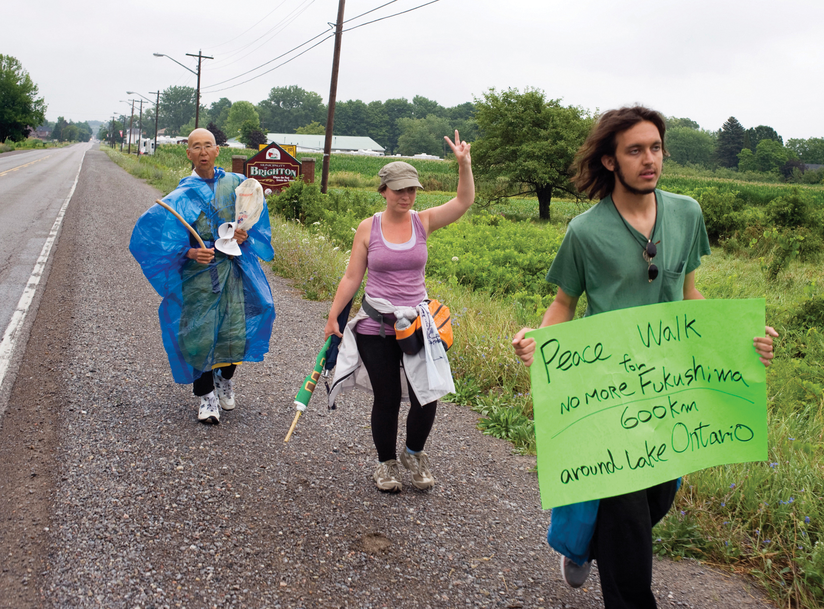 BRIGHTON --  Buddhist nun Jun Yasuda, left, Lauren Carlbon and Alex Ciccolo on their recent peace walk through Brighton. Ms. Yasuda and her fellow walkers are traveling 600 km around Lake Ontario to spread awareness about the dangers of nuclear energy and weapons. July 26, 2012.