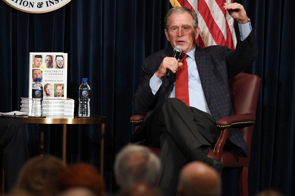 """Former US President George W. Bush speaks at the Ronald Reagan Presidential Library as he promotes his upcoming book """"Portraits of Courage: A Commander in Chief's Tribute to America's Warriors"""" in Simi Valley, California on March 1, 2017. / AFP PHOTO / Mark RALSTON        (Photo credit should read MARK RALSTON/AFP/Getty Images)"""