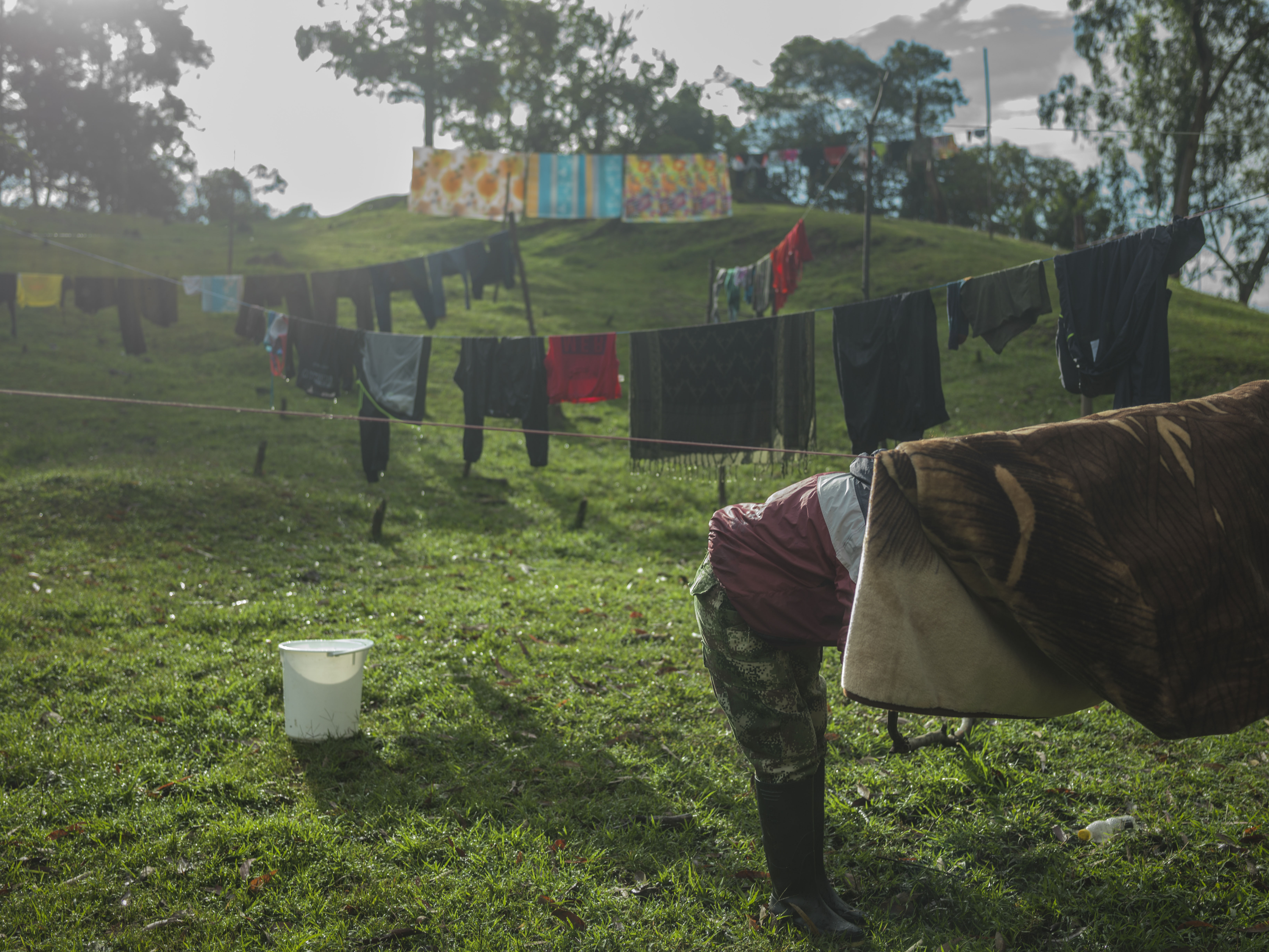 COLOMBIA. 2017. Guerrillas washing clothes and blankets.