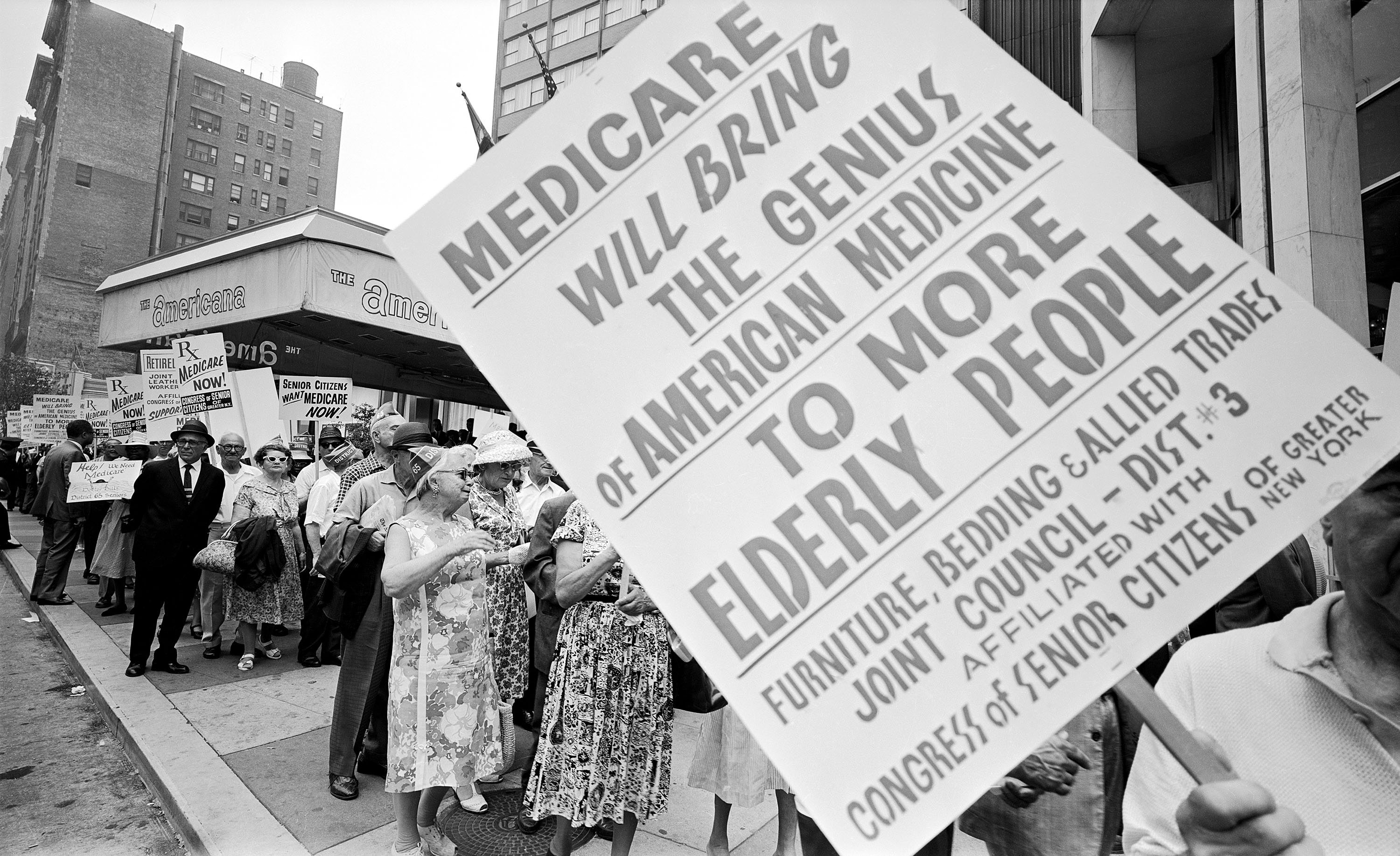 Retired Senior Citizens Carrying Pro-Medicare Signs
