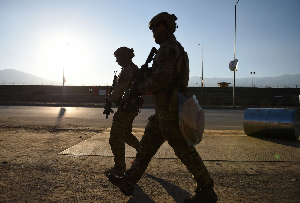 US soldiers arrive at the site of a suicide car bombing that targeted an Afghan police district headquarters building as a gun battle continues between Taliban and Afghan security forces in Kabul on March 1, 2017.Explosions and gunfire echoed through Kabul after near simultaneous Taliban suicide assaults on two security compounds, as the insurgents ramp up attacks even before the start of their annual spring offensive. / AFP / WAKIL KOHSAR (Photo credit should read WAKIL KOHSAR/AFP/Getty Images)