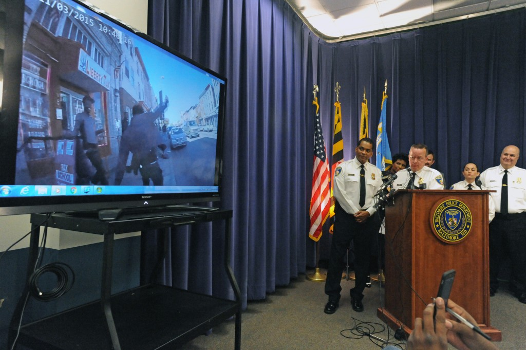 Baltimore City police commissioner Kevin Davis, at podium, shows a sample of footage from a body camera worn by a police officer during a news conference at police headquarters on Monday, Dec. 21, 2015. (Kenneth K. Lam/Baltimore Sun/TNS via Getty Images)