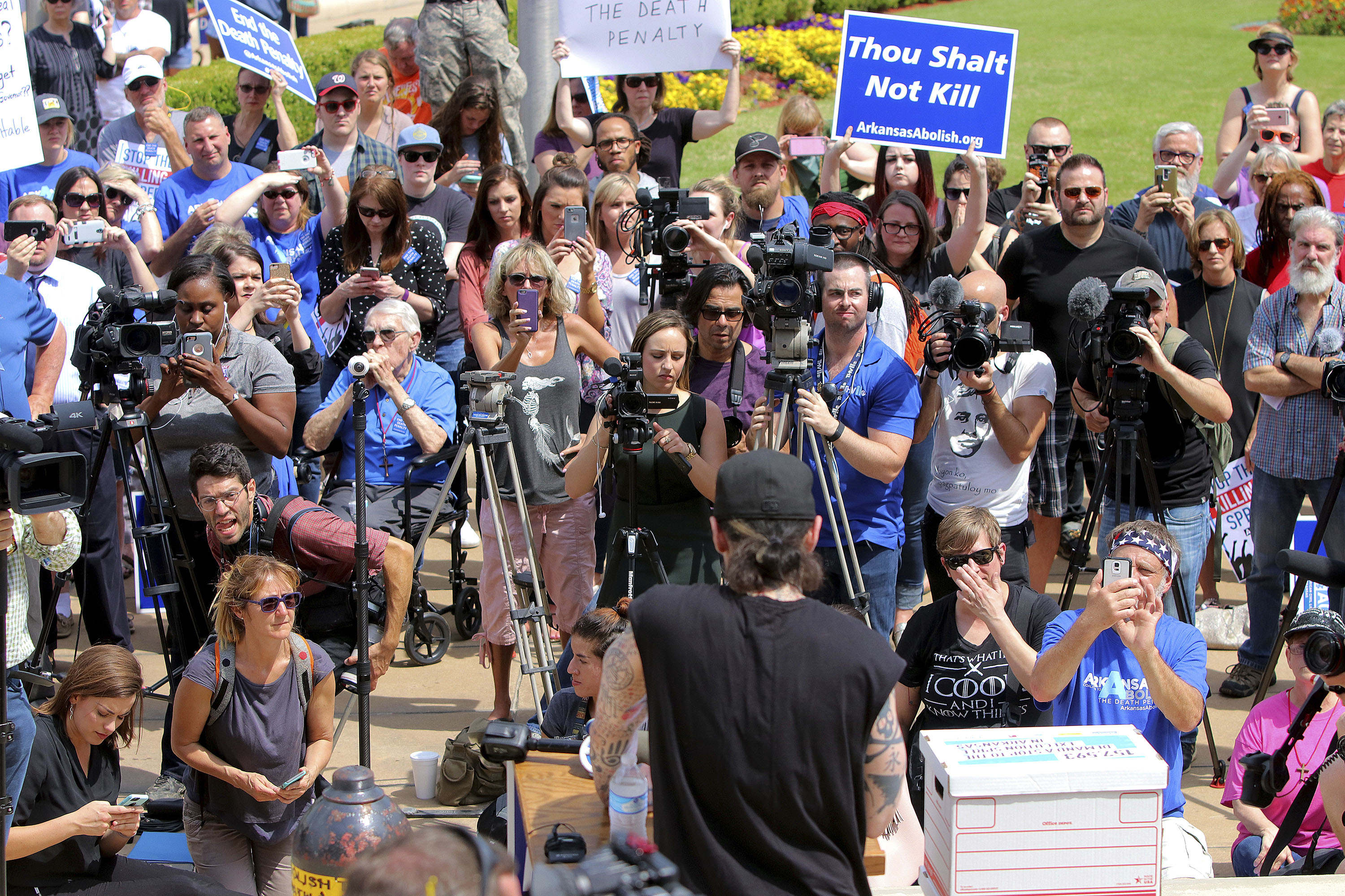 Former Arkansas death row inmate Damien Echols, center, back to camera, speaks at rally opposing the state's upcoming executions, on the front steps of Arkansas' Capitol, Friday, April 14, 2017, in Little Rock, Ark. (Stephen B. Thornton/The Arkansas Democrat-Gazette via AP)