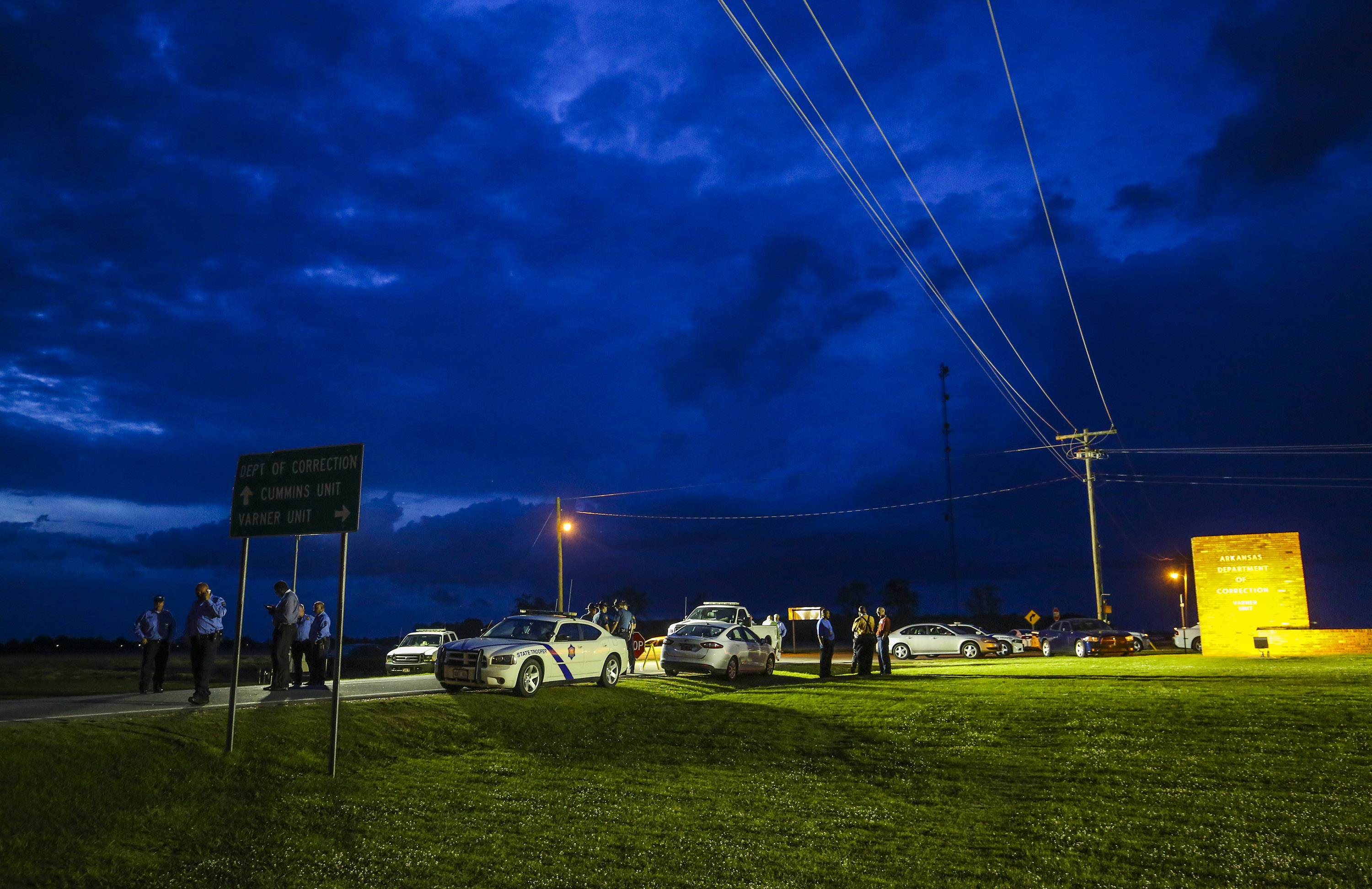 In this Monday evening, April 17, 2017 photo, the sun sets behind clouds over an Arkansas State Police command post outside the Varner Unit of the Arkansas Department of Correction near Varner, Ark. As state officials prepare to carry out a double execution Thursday ahead of a drug expiration deadline and despite the setback the U.S. Supreme Court delivered late Monday, lawyers for those condemned men look to be taking a different approach: claiming the prisoners are actually innocent. (Stephen B. Thornton/The Arkansas Democrat-Gazette via AP)