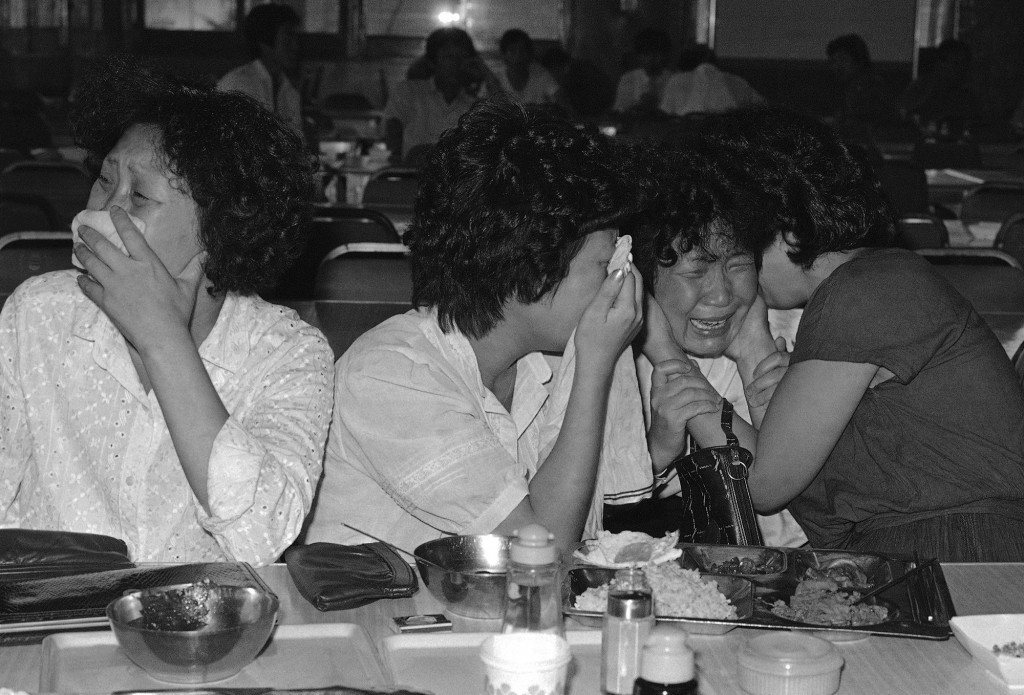 "Sisters of Lee Chul-Kyu, a passenger on the Ill-fated Korean-Air Lines 747 jetliner, weep, Sept. 2, 1983, as South Korean government spokesman Lee Jin-Hie announced in Seoul, that it was ""almost certain"" the jetliner had been shot down en route to Seoul, South Korea. (AP Photo/Kim Chon-Kil)"