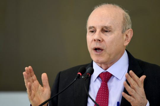 Brazilian Finance Minister Guido Mantega speaks during a meeting  of the Council of Economic and Social Development at the Palacio do Planalto in Brasilia on June 5, 2014. At one week of the start of the FIFA World Cup Brazil 2104, the government faces threats of strikes in various sectors like transportation, public safety and education, besides protests in all the host cities of the World Cup. AFP PHOTO/Evaristo SA        (Photo credit should read EVARISTO SA/AFP/Getty Images)
