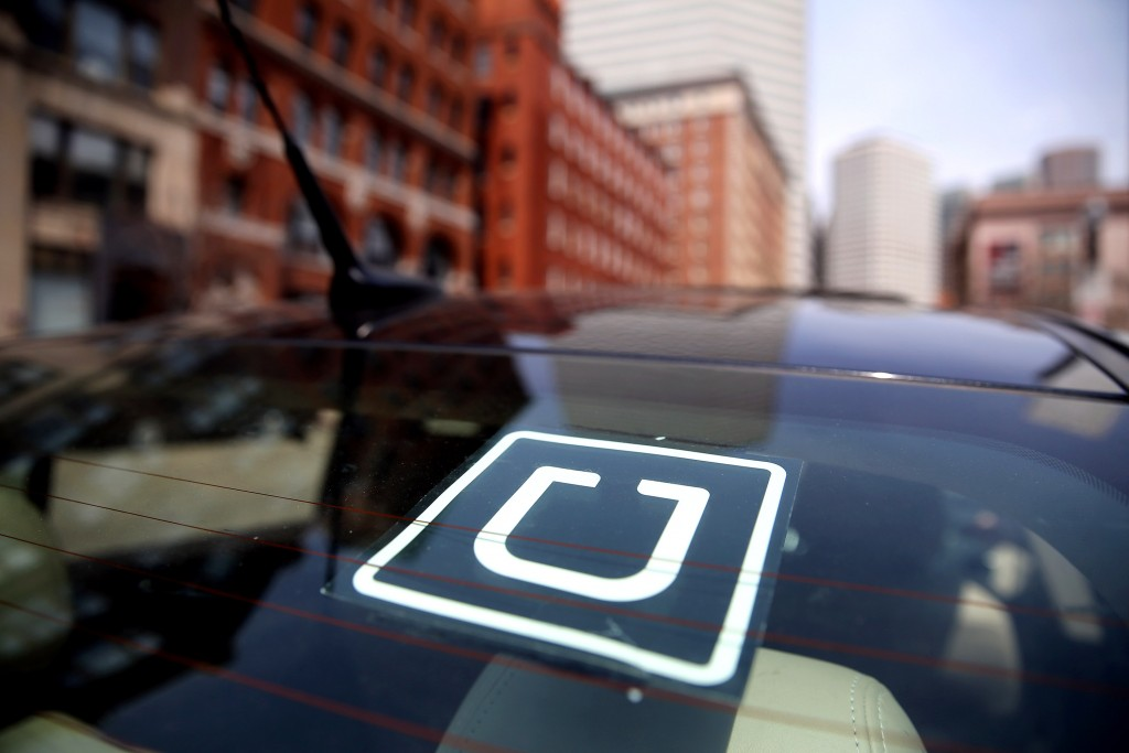 BOSTON - APRIL 22: Uber driver Dean Johnson waits for a customer outside South Station in Boston on April 22, 2016. (Photo by Craig F. Walker/The Boston Globe via Getty Images)
