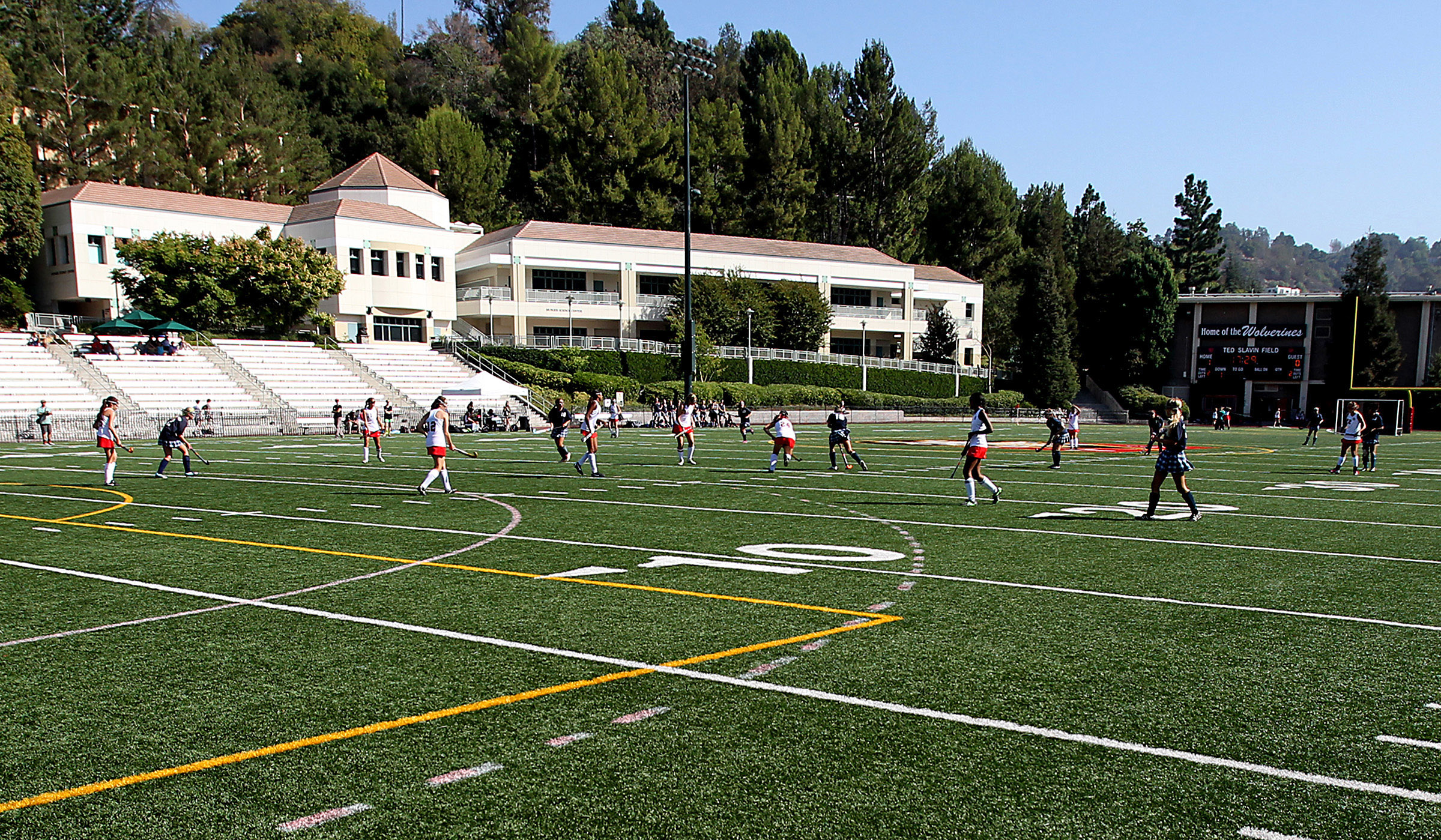 Girls play a game of field hockey on the athletic fields of  Harvard-Westlake School, an independent coeducational college preparatory day school, with grades 7-12, in Studio City. It costs about $40,000 a year for tuition, and boasts a high success rate in getting kids admitted into Ivy League universities.  (Photo by Luis Sinco/Los Angeles Times via Getty Images)