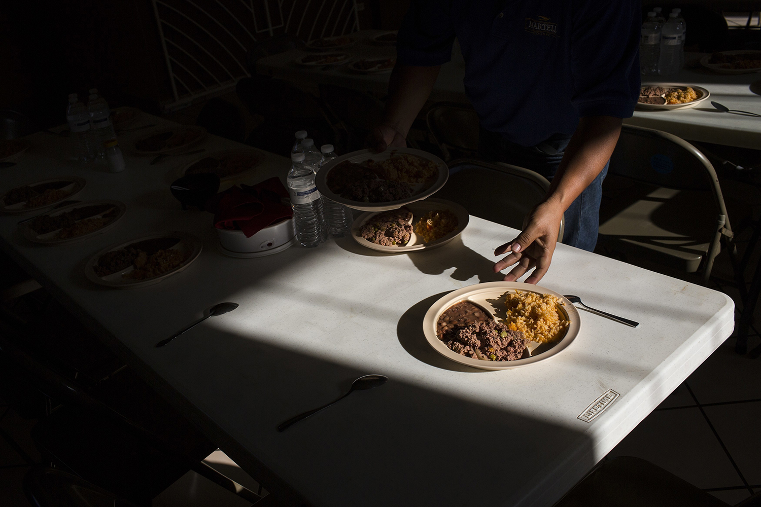 """Migrants have a dinner of rice and beans at the migrant shelter """"Casa del Migrante"""" in Nuevo Laredo, Tamaulipas state, Mexico, Saturday, March 25, 2017, across the border from Laredo, Texas. Some Cubans have been stuck here since then-President Barack Obama on Jan. 12 ended the so-called """"wet foot, dry foot"""" policy that had given Cubans a privileged path to the U.S. Until then, nearly any Cubans reaching U.S. soil had the right to stay, but now they are treated like migrants from other nations, facing a much tougher barrier. (AP Photo/Rodrigo Abd)"""