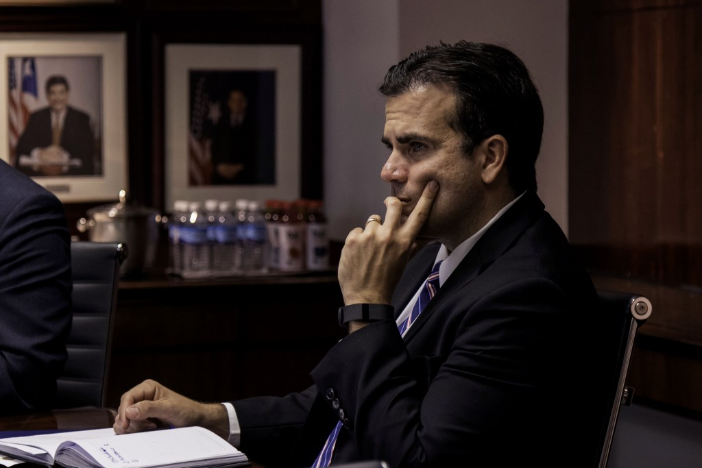 | Ricardo Rossello governor of Puerto Rico listens during a meeting at Puerto Rico Industrial Development Company PRIDCO headquarters in San Juan Puerto Rico US on Tuesday March 28 2017 Puerto Ricos economy has been contracting for a decade Last year almost 65000 residents left the island keeping pace with the previous two years when the exodus reached the worst since at least the 1980s Photographer Alejandro GranadilloBloomberg via Getty Images | MR Online