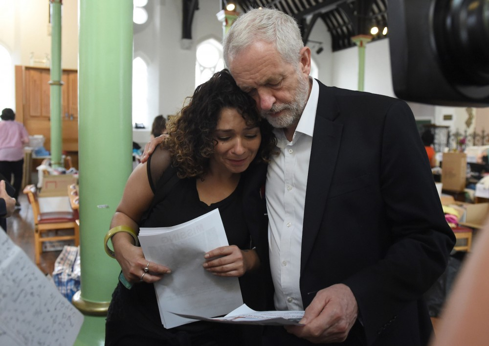 """Jeremy Corbyn comforting a survivor of Grenfell Tower fire while Theresa May avoid survivors because of """"security reason"""""""