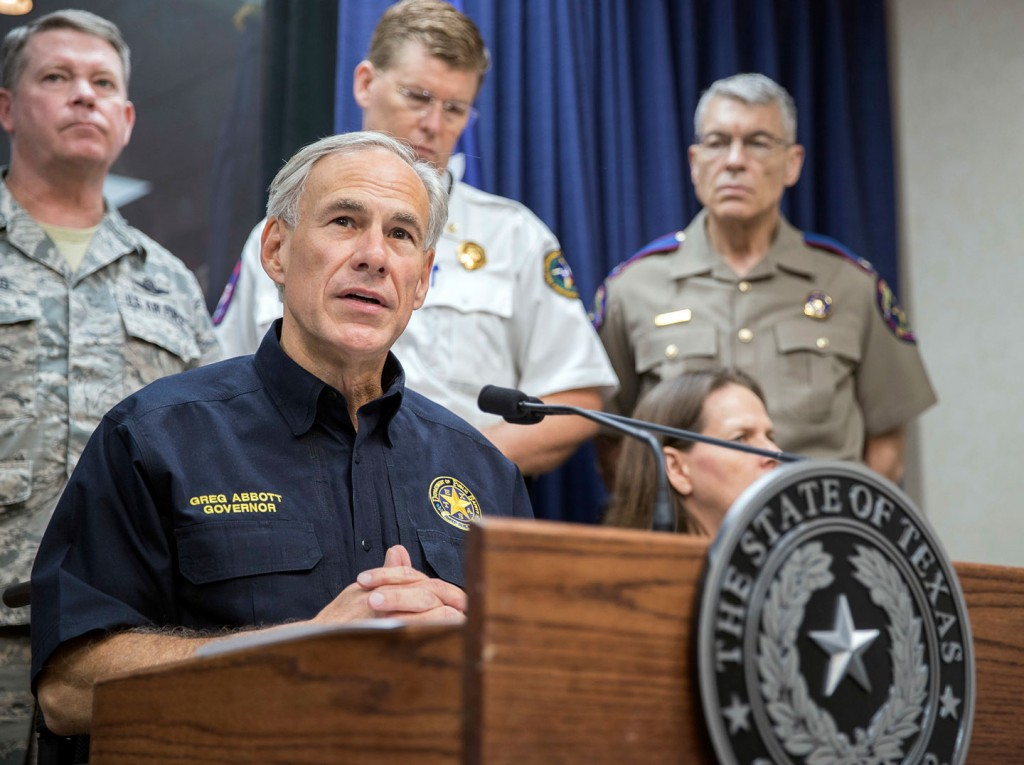 """FILE- In this Aug. 30, 2017, file photo, Texas Gov. Greg Abbott speaks during a press briefing the State of Texas Emergency Command Center at Department of Public Safety headquarters in Austin, Texas. A federal judge late Wednesday temporarily blocked most of Texas' tough new """"sanctuary cities"""" law that would have let police officers ask people during routine stops whether they're in the U.S. legally and threatened sheriffs will jail time for not cooperating with federal immigration authorities. Abbott, who signed the law in May, said Texas would appeal immediately and expressed confidence that the state would eventually prevail. (Ricardo B. Brazziell/Austin American-Statesman via AP, File)"""