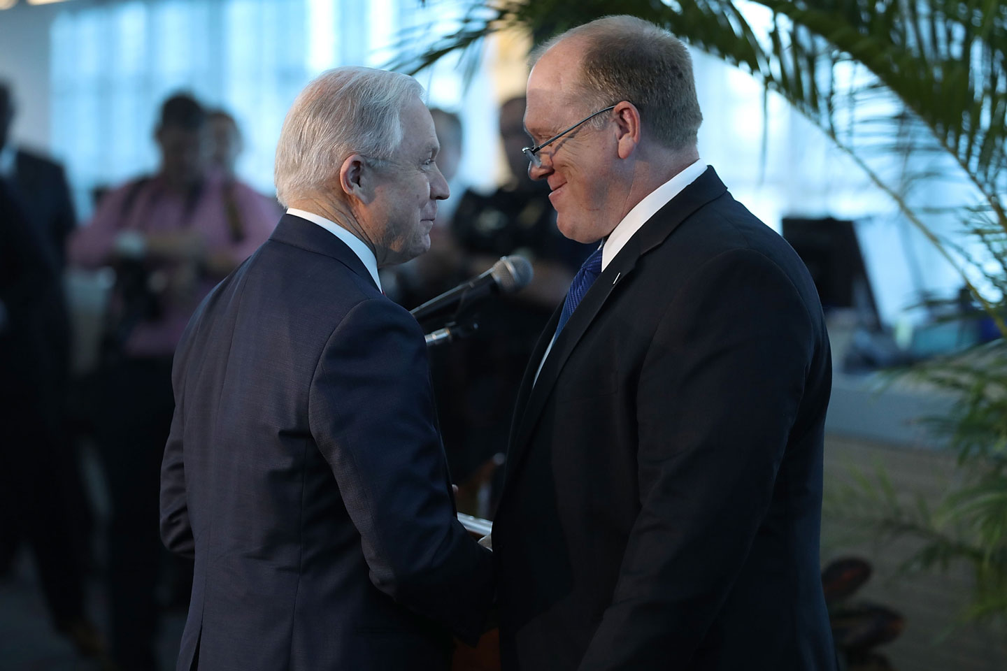 MIAMI, FL - AUGUST 16: U.S. Attorney General Jeff Sessions (L) is introduced by Acting Director Tom Homan, U.S. Immigration and Customs Enforcement before he speaks at PortMiami on what he said is a growing trend of violent crime in sanctuary cities on August 16, 2017 in Miami, Florida. The speech highlighted jurisdictions like Miami-Dade that Mr. Sessions told the audience have increased their cooperation and information sharing with federal immigration authorities and have demonstrated a fundamental commitment to the rule of law and lowering violent crime. (Photo by Joe Raedle/Getty Images)