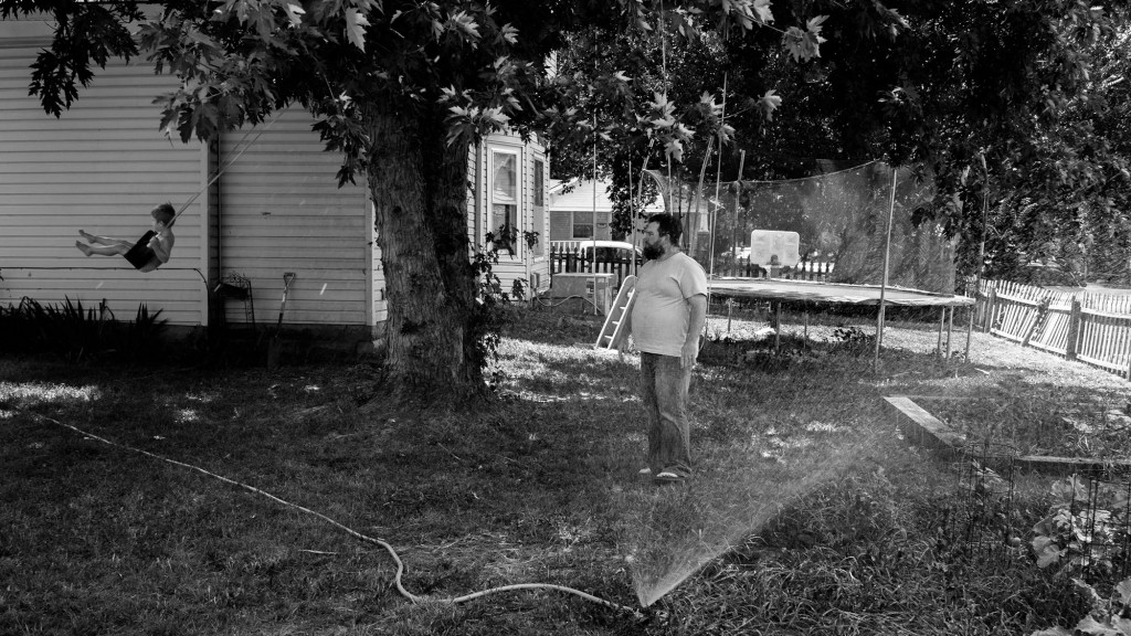 Seth pushes his son, Owen, in the backyard. Seth takes Owen and his younger brother into Wichita to receive pediatric care. Many in Wellington attribute Sumner Regional Medical Center's financial trouble to the fact that many of the town's residents choose to receive medical care elsewhere. Wellington, KS. July 16, 2017.