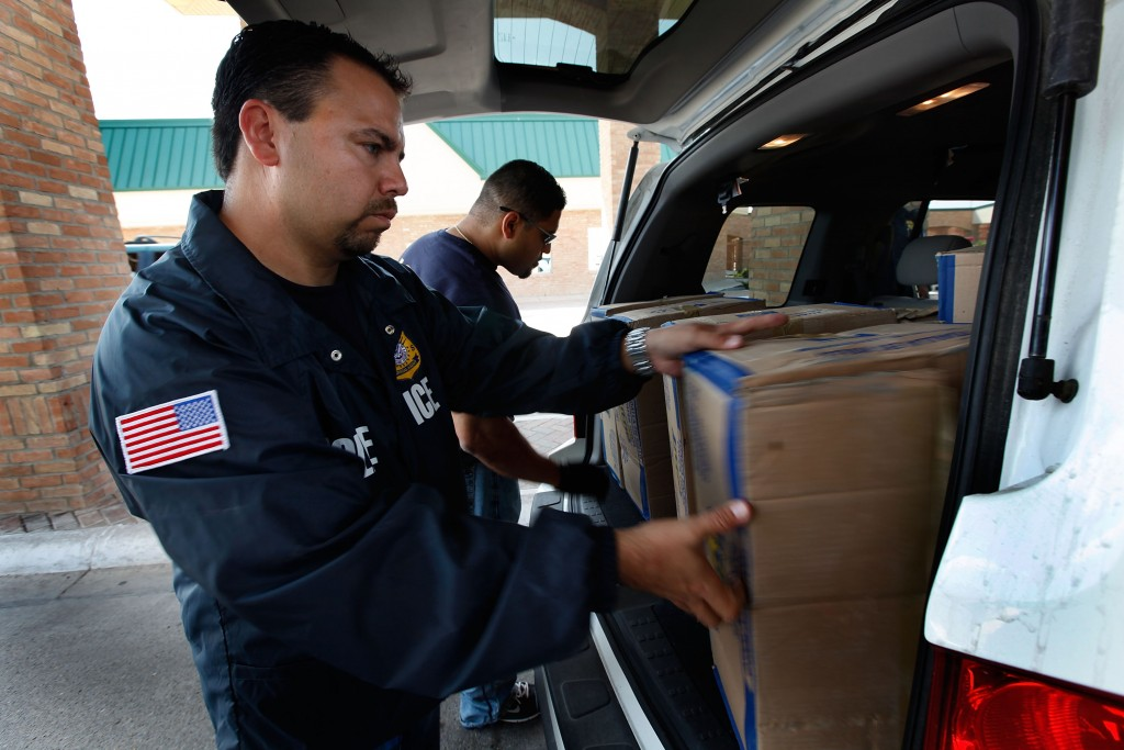 HIDALGO, TX - MAY 28: Special agents from Immigration and Customs Enforcement (ICE) search a vehicle heading into Mexico at the Hidalgo border crossing on May 28, 2010 in Hidalgo, Texas. The inspection was part of a Department of Homeland Security (DHS) joint effort between ICE, Customs and Border Protection (CBP) and Customs and Border Patrol. The organizations are trying to slow the flow of guns, money and drugs from the United State into Mexico. (Photo by Scott Olson/Getty Images)