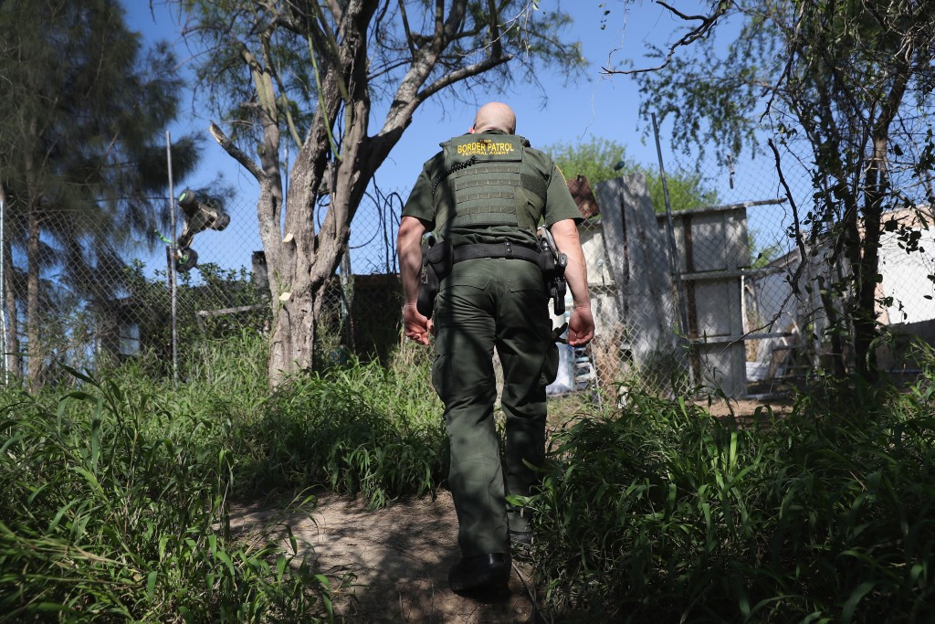 ROMA, TX - MARCH 14: A U.S. Border Patrol agent climbs up from the bank of the Rio Grande at the U.S.-Mexico border on March 14, 2017 in Roma, Texas. He and fellow agents had intercepted a group of undocumented immigrants on the Texas side of the river and pushed them back into Mexico. (Photo by John Moore/Getty Images)