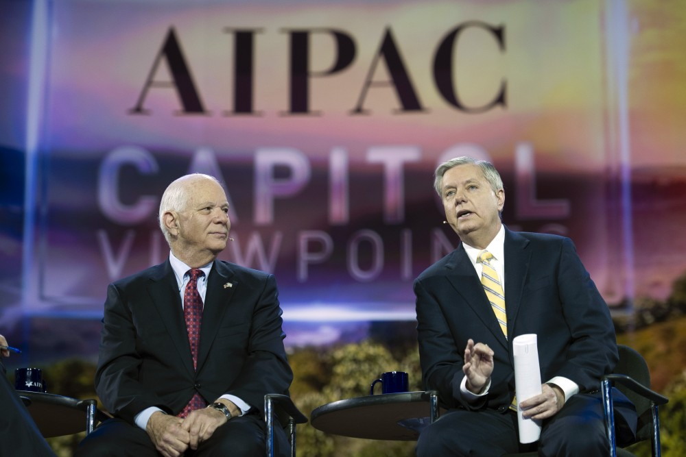 Sen. Ben Cardin, D-Md., left, listens as Sen. Lindsey Graham, R-S.C., speaks during their appearance at the American Israel Public Affairs Committee (AIPAC) Policy Conference in Washington, Sunday, March 1, 2015. (AP Photo/Cliff Owen)