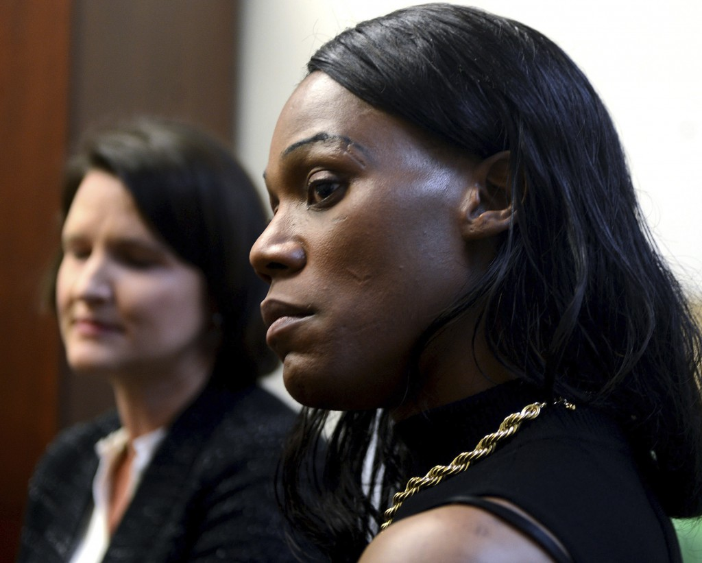 Jules Williams, 37, right, a transgender woman, looks on during a news conference following the filing of a lawsuit on her behalf by the American Civil Liberties Union of Pennsylvania against Allegheny County, Monday Nov. 6, 2017, in Pittsburgh. Williams claims that she was repeatedly physically and sexually assaulted during stays in the Allegheny County Jail because the staff refused to place her with female inmates. (Nate Guidry/Pittsburgh Post-Gazette via AP)