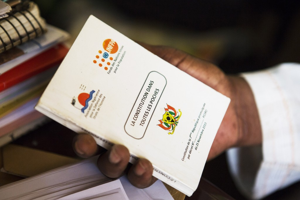 Activist and head of Alternatives NGO Moussa Tchangari holds a copy of the Nigerien constitution at his office in Niamey, Niger, January 10, 2018.