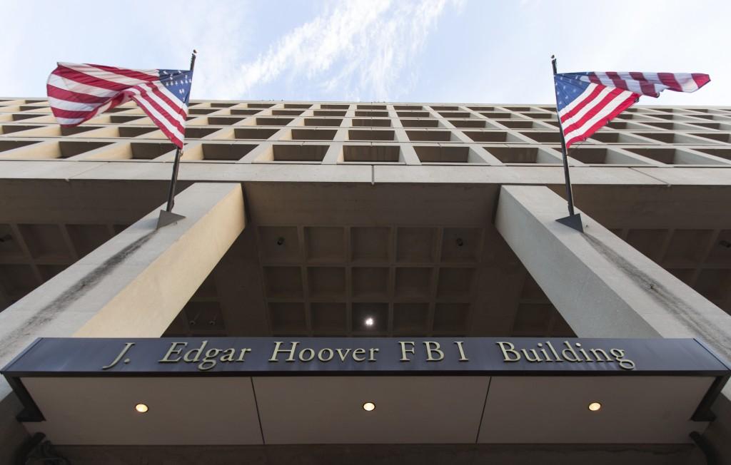 The Pennsylvania Avenue entrance of the J. Edgar Hoover Federal Bureau of Investigations (FBI) Building is seen in Washington, Thursday, Nov. 30, 2017. (AP Photo/Carolyn Kaster)