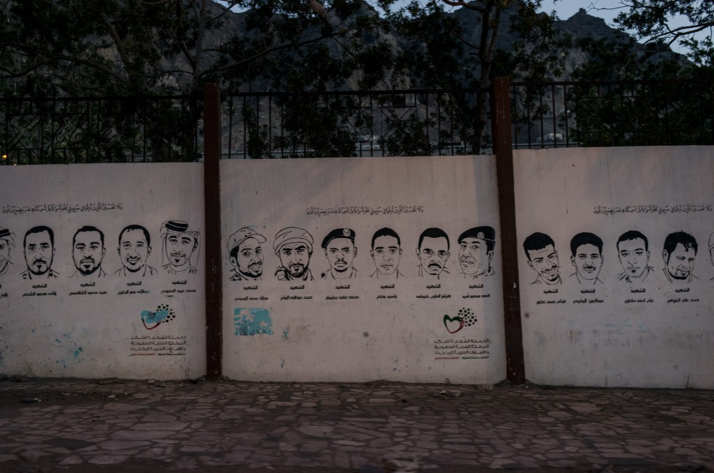 Images of Yemenis killed in the 2015 battle against the Houthis are painted on the walls of main streets on April 23 in Aden, Yemen