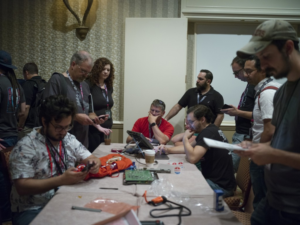 Las Vegas, Nevada, July 28, 2017. Hackers examine a voting machines during DEF CON a gathering of info security professionals.