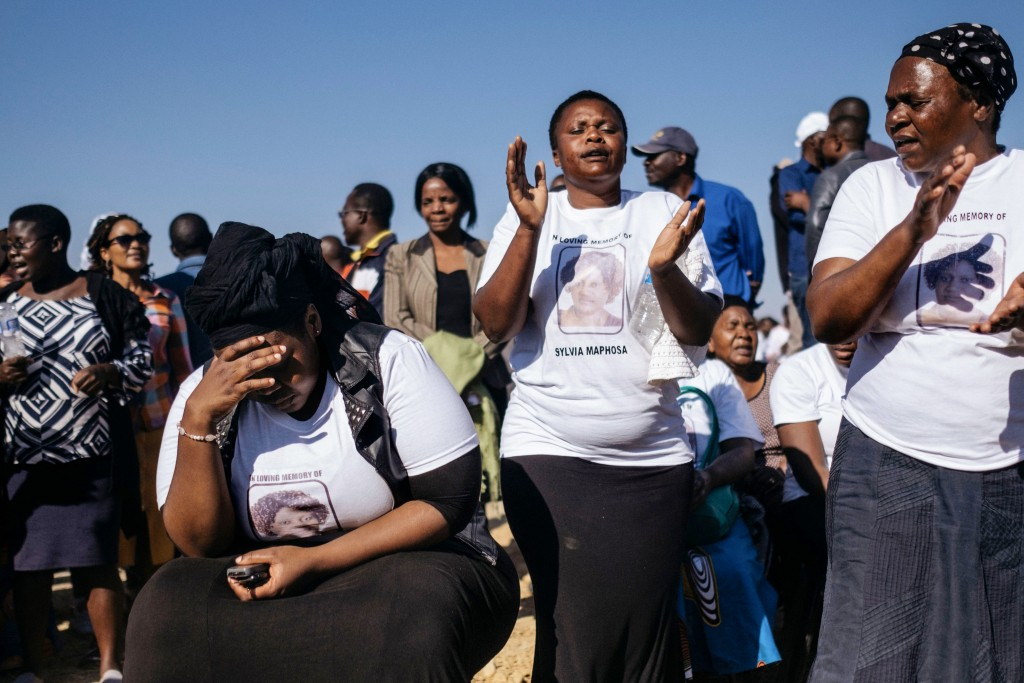 Relatives and friends mourn on August 4, 2018 at the end of the funeral gathering for Sylvia Maphosa, shot during the post election violence in Harare on August 1, the day after the nation went to the polls in national elections. - At least six people died after troops in the capital Harare opened fire on demonstrators on August 1, alleging that President Emmerson Mnangagwa had stolen the election from MDC leader Nelson Chamisa. (Photo by MARCO LONGARI / AFP) (Photo credit should read MARCO LONGARI/AFP/Getty Images)