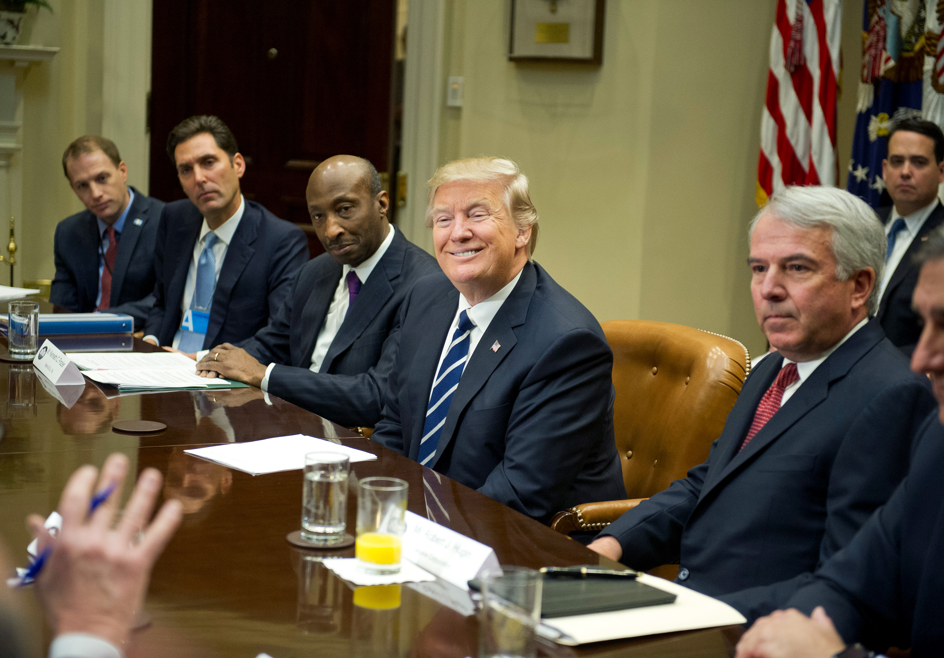 "WASHINGTON, DC - JANUARY 31: (AFP OUT) U.S. President Donald Trump meets with representatives from PhRMA, the Pharmaceutical Research and Manufacturers of America, in the Roosevelt Room of the White House on January 31, 2017 in Washington, DC. According to its website PhRMA ""represents the countrys leading biopharmaceutical researchers and biotechnology companies."" From left to right: Josh Pitcock, Chief of Staff to the Vice President; Stephen Ubl, President and CEO, PhARMA; Kenneth C. Frazier, Chairman and CEO of Merck & Co; the President; and Robert J. Hugin, Executive Chairman, Celgene Corporation. (Photo by Ron Sachs - Pool/Getty Images)"