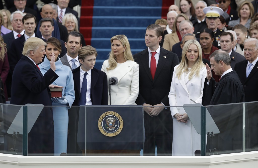 2017 AP YEAR END PHOTOS - Donald Trump is sworn in as the 45th president of the United States by Chief Justice John Roberts, as Melania Trump and his family looks on during the 58th Presidential Inauguration at the U.S. Capitol in Washington, on Jan. 20, 2017. (AP Photo/Patrick Semansky)