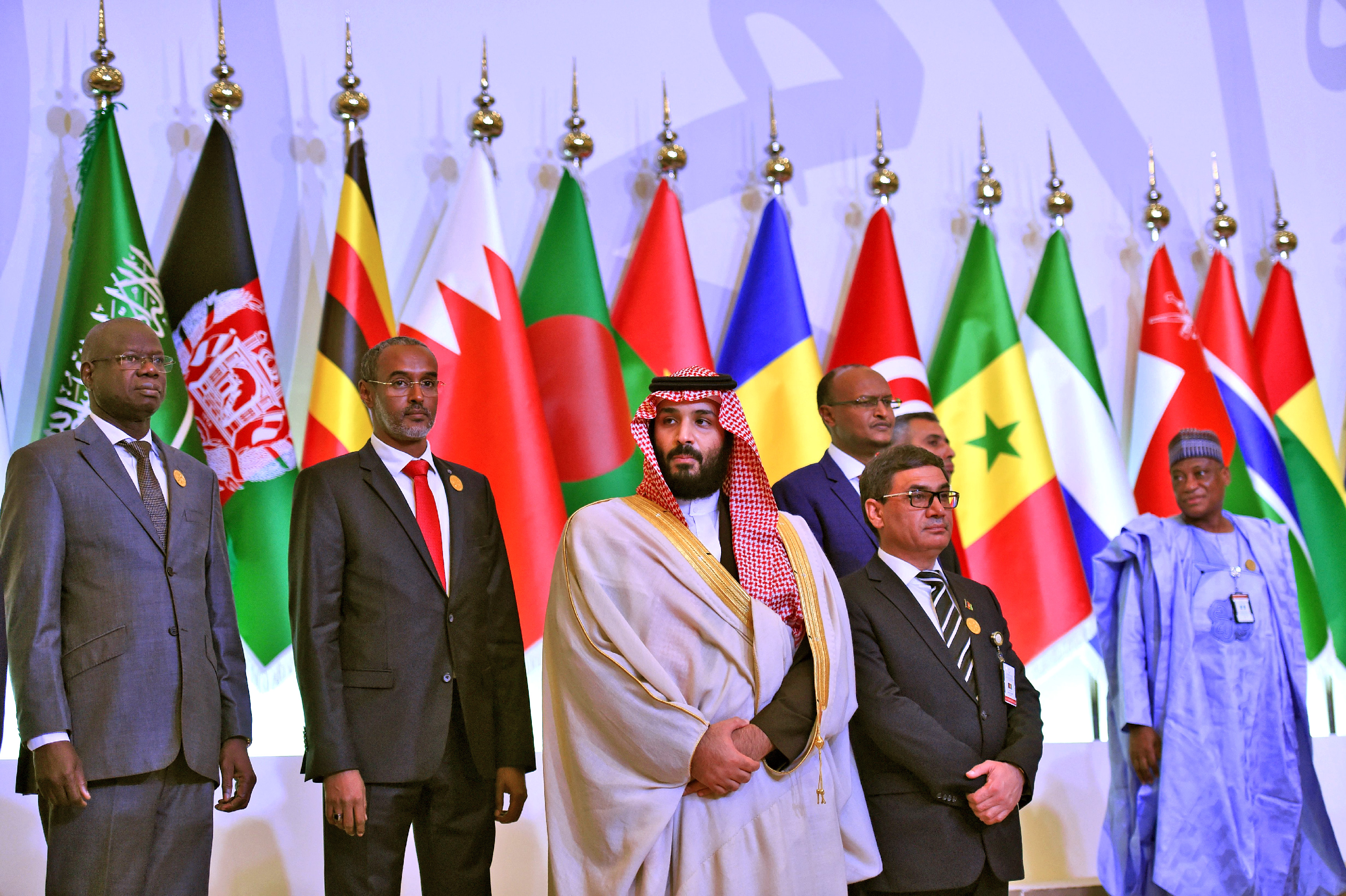 Saudi Crown Prince and Defence Minister Mohammed bin Salman (C) poses for a group picture with other defence ministers and officials of the 41-member Saudi-led Muslim counter-terrorism alliance on November 26, 2017 in the capital Riyadh, including Jordan's Chairman of the Joint Chiefs of Staff Lieutenant General Mahmoud Freihat (L) and Afghanistan's acting Defence Minister Major General Tariq Shah Bahrami (R). This is the first official meeting of the 41-member Islamic Military Counter Terrorism Coalition, first formed in 2015 under the auspices of Prince Mohammed -- whose rapid ascent since his appointment as heir to the throne in June has shaken the regional political scene. / AFP PHOTO / Fayez Nureldine (Photo credit should read FAYEZ NURELDINE/AFP/Getty Images)