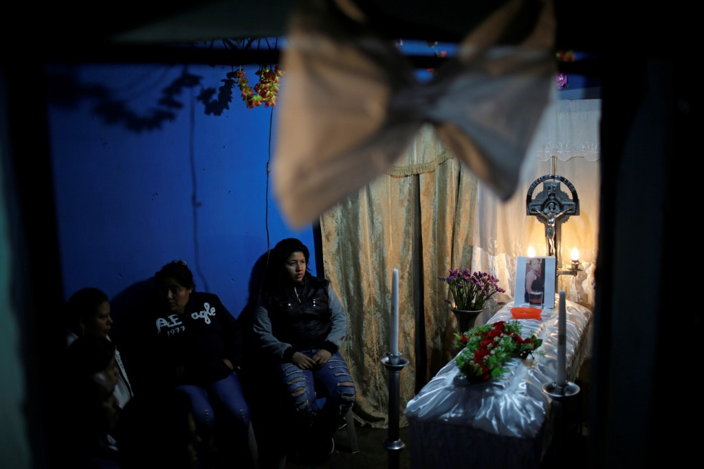 Family and friends attend the wake of Madelin Patricia Hernandez, a victim of a fire at the Virgen de Asuncion children shelter, at her grandmother's home in Guatemala City, Guatemala March 9, 2017. REUTERS/Saul Martinez - RC18CDE59090