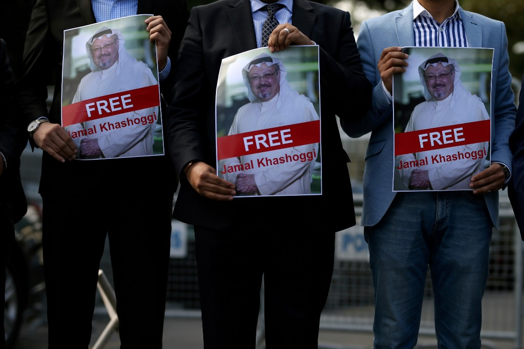 Holding pictures of missing Saudi writer Jamal Khashoggi, people gather in his support, near the Saudi Arabia consulate in Istanbul, Friday, Oct. 5, 2018. Khashoggi, a 59-year-old veteran journalist who has lived in self-imposed exile in the U.S. since Prince Mohammed's rise to power, disappeared Oct. 2 while on a visit to the consulate to get paperwork done to be married to his Turkish fiancee. The Saudi Consulate insists Khashoggi left its building, contradicting Turkish officials who say they believe he is still there. (AP Photo/Emrah Gurel)