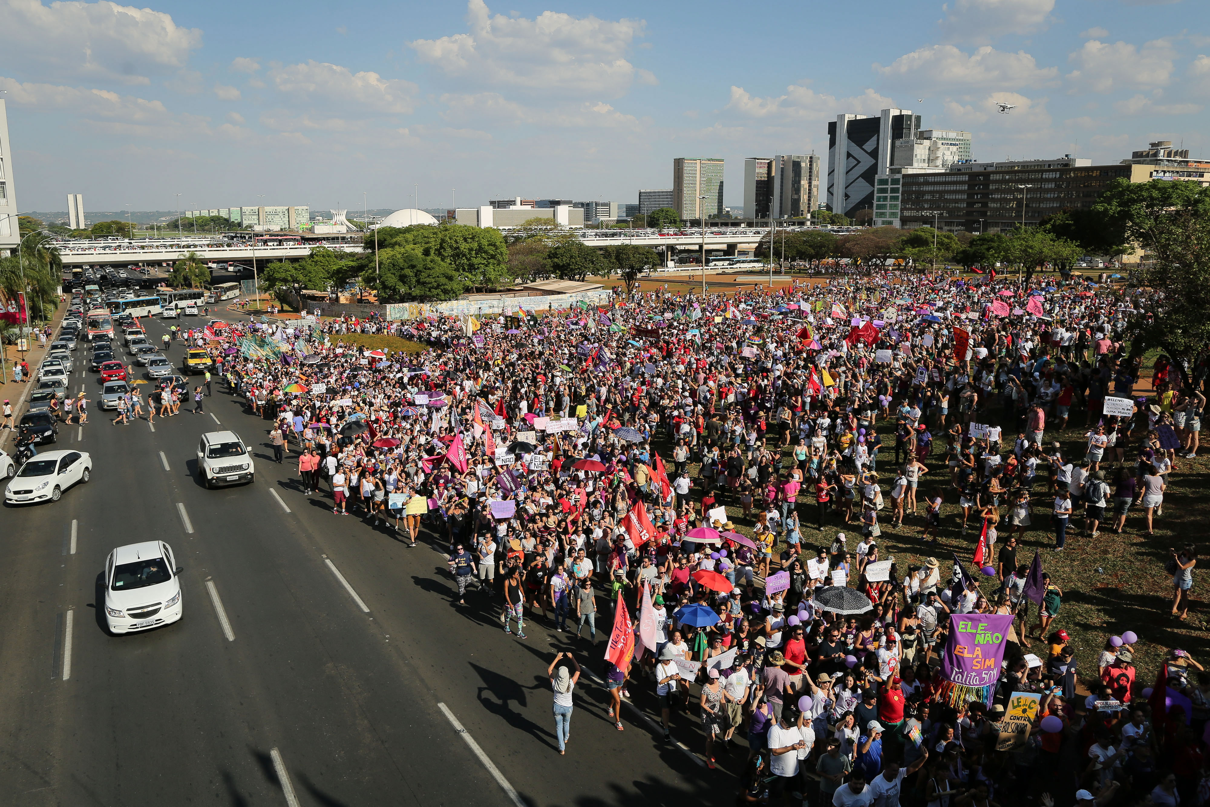 Demonstrators take part in a protest against Brazilian right-wing presidential candidate Jair Bolsonaro, called by a social media campaign under the hashtag #EleNao (Not Him), in Brasilia on September 29, 2018. - Women across Brazil launched a wave of nationwide protests on Saturday against the candidacy of the right-wing frontrunner in next week's presidential elections, Jair Bolsonaro who has been branded racist, misogynist and homophobic. (Photo by Sergio LIMA / AFP)