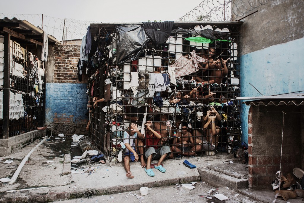 SAN SALVADOR, EL SALVADOR - MAY 20: MS-13 gang members languish in one of the three 'gang cages' in the Quezaltepeque police station May 20, 2013 in San Salvador, El Salvador. These overcrowded, 12x15 cages were designed to be 72-hour holding cells for common criminals and the two rival gangs, but many of the individuals have been imprisoned for over a year. (Photo by Giles Clarke/Getty Images.)