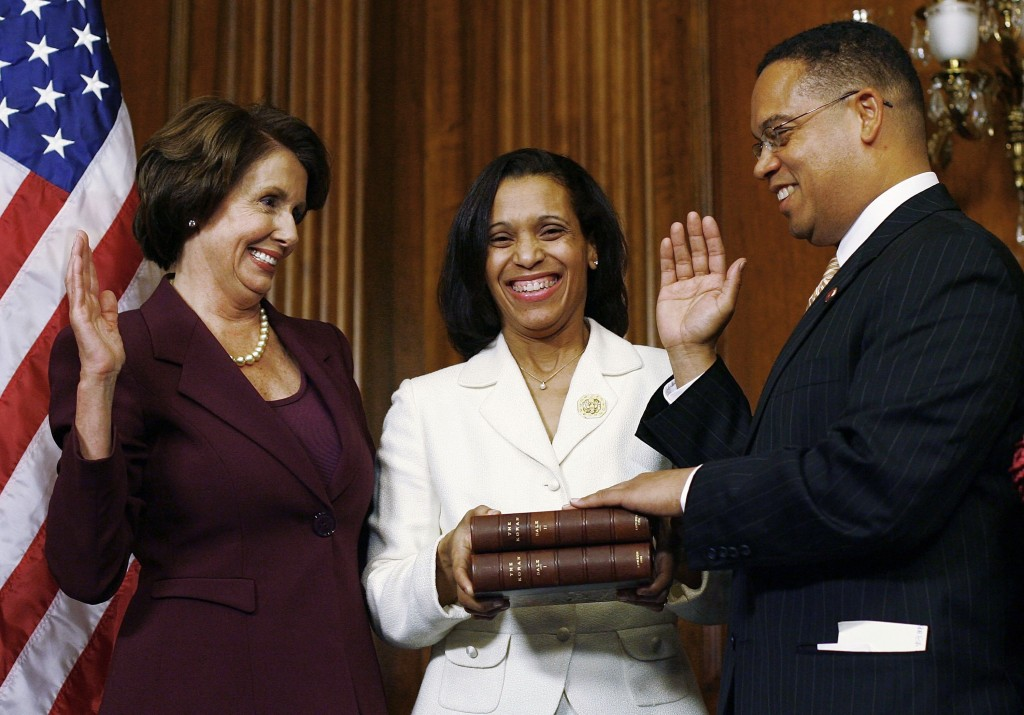 WASHINGTON - JANUARY 04: U.S. Rep. Keith Ellison (D-MN) (R) takes his oath of office by swearing on a Koran during a ceremonial swearing in with Speaker of the House Nancy Pelosi (L) and his wife Kim (C) at the U.S. Capitol January 4, 2007 in Washington, DC. Ellison is the first Muslim elected as a U.S. Congressman. (Photo by Win McNamee/Getty Images)