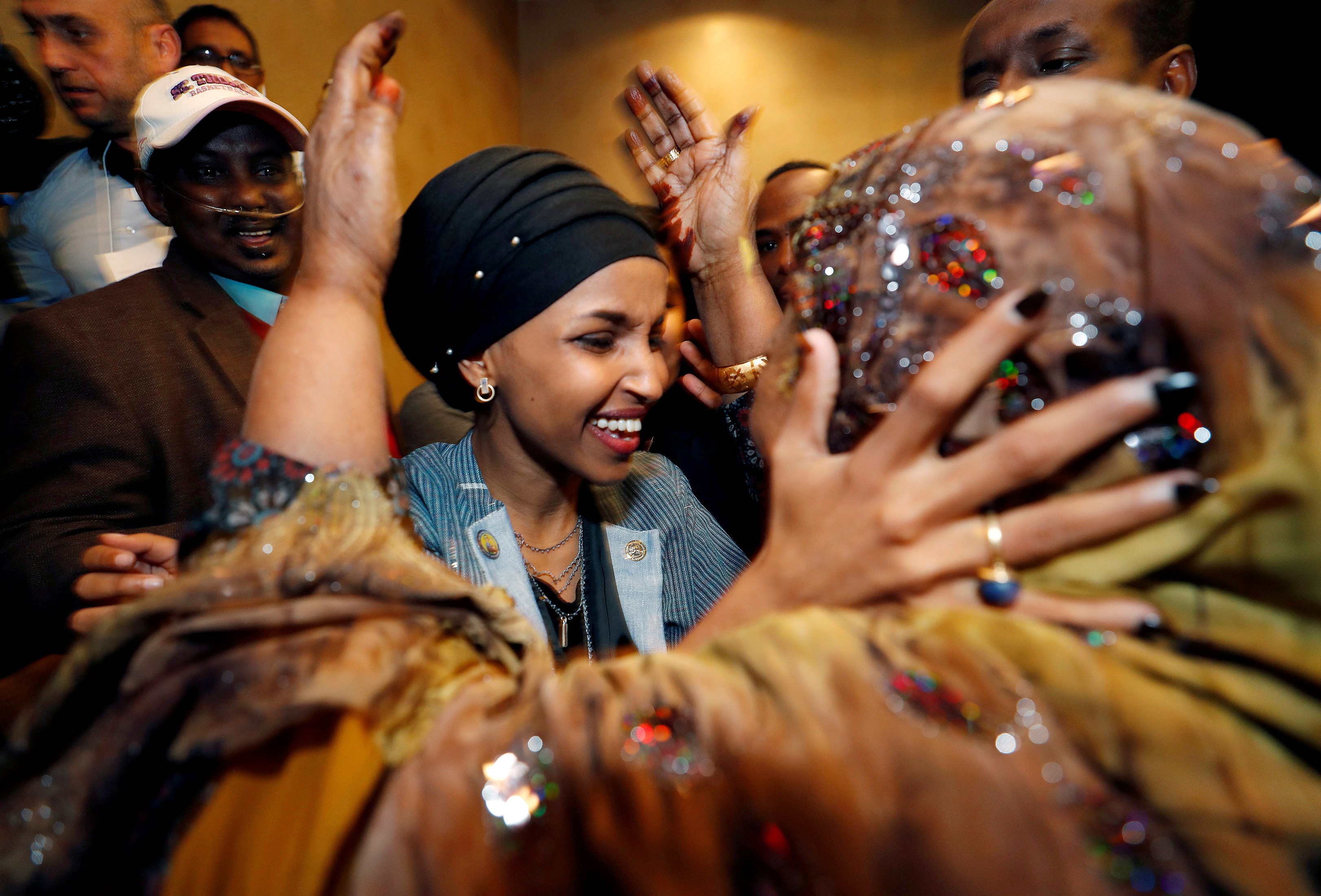 Democratic congressional candidate Ilhan Omar is greeted by her husband?s mother after appearing at her midterm election night party in Minneapolis, Minnesota, U.S. November 6, 2018. REUTERS/Eric Miller     TPX IMAGES OF THE DAY - RC194080F1B0
