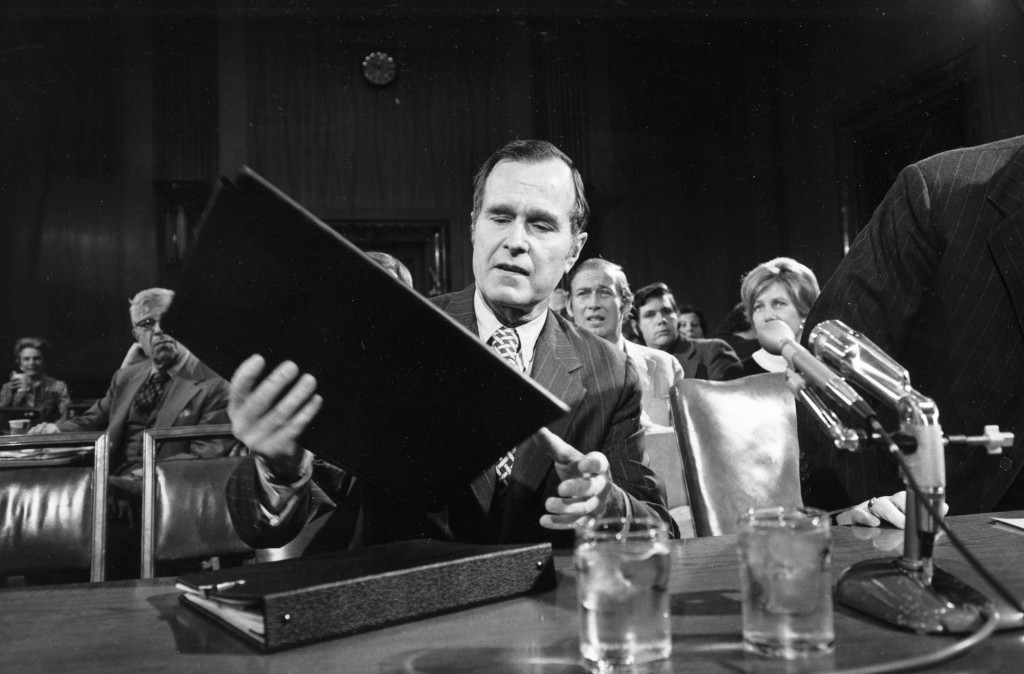 George Bush looks over his material prior to delivering testimony before the Senate Armed Services Committee on his qualification for the job of CIA director, in Washington, D.C., Dec. 15, 1975.  (AP Photo)