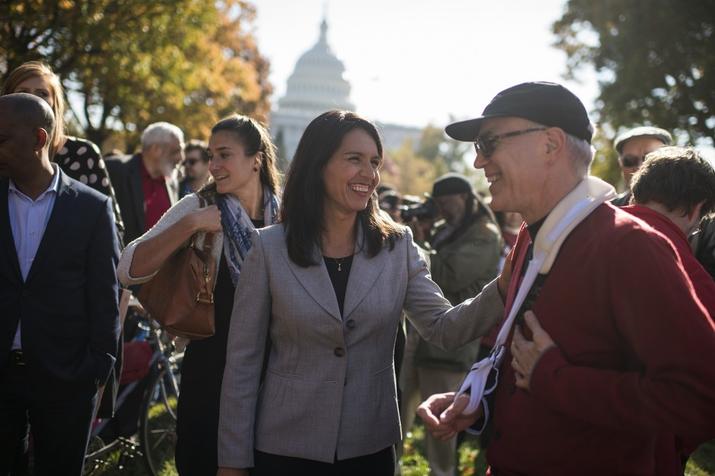 UNITED STATES - NOVEMBER 17: Rep. Tulsi Gabbard, D-Hawaii, attends a rally held by labor, environmental, and consumer groups in Upper Senate Park featuring an address by Sen. Bernie Sanders, I-Vt., to call for economic and social justice, November 17, 2016. (Photo By Tom Williams/CQ Roll Call)