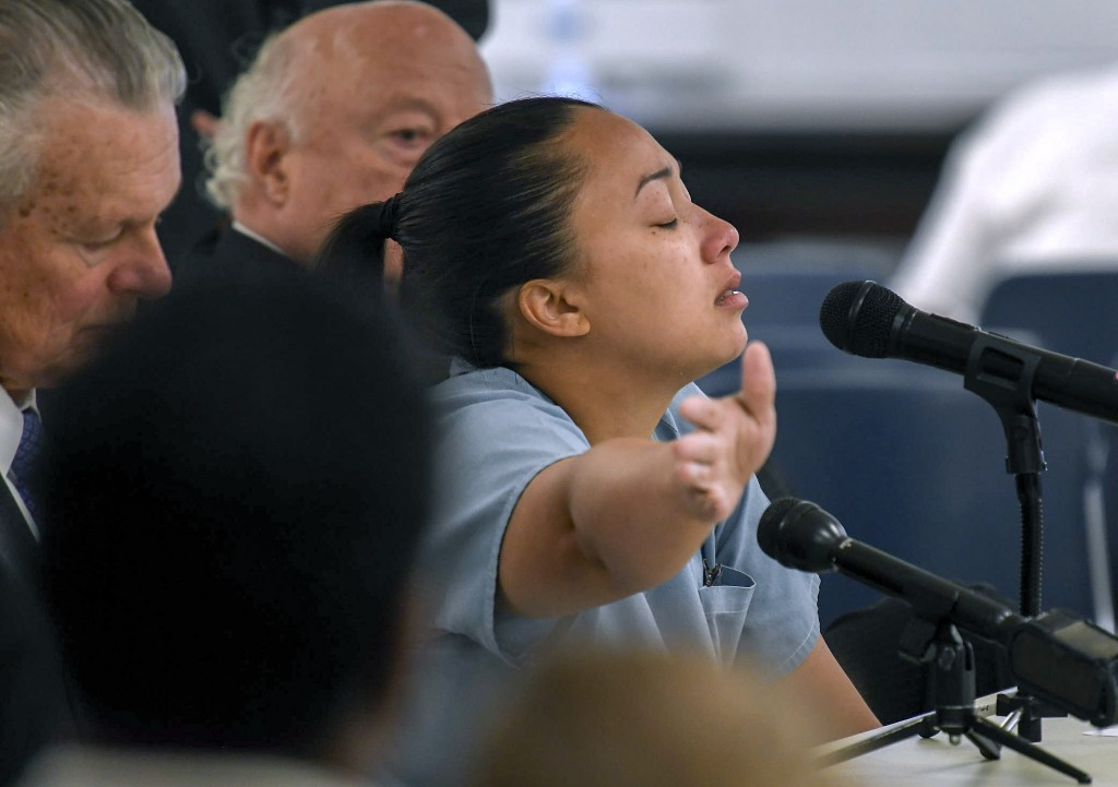 "Cyntoia Brown sits between council and says, "" Johnny Allen's life mattered"" as she pledges that she will never kill again to the parole board during her clemency hearing at the Tennessee Prison for Women in Nashville, Tenn., Wednesday, May 23, 2018. A six-member Tennessee Board of Parole is divided on whether to release Brown, who is serving a life sentence, for killing a man when she was a 16-year-old prostitute. (Lacy Atkins/The Tennessean via AP, Pool)"