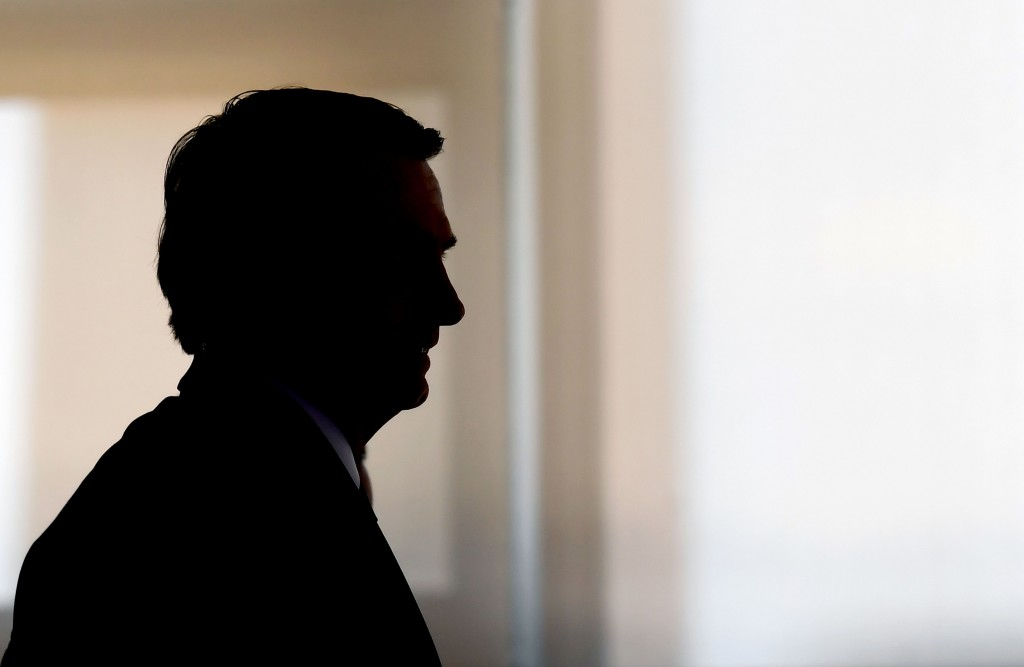 TOPSHOT - Brazilian President Jair Bolsonaro is silhouetted during the appointment ceremony of the new heads of public banks, at Planalto Palace in Brasilia on January 7, 2019. - Brazil's Finance Minister Paulo Guedes appointed the new presidents of the country's public banks. (Photo by EVARISTO SA / AFP)        (Photo credit should read EVARISTO SA/AFP/Getty Images)