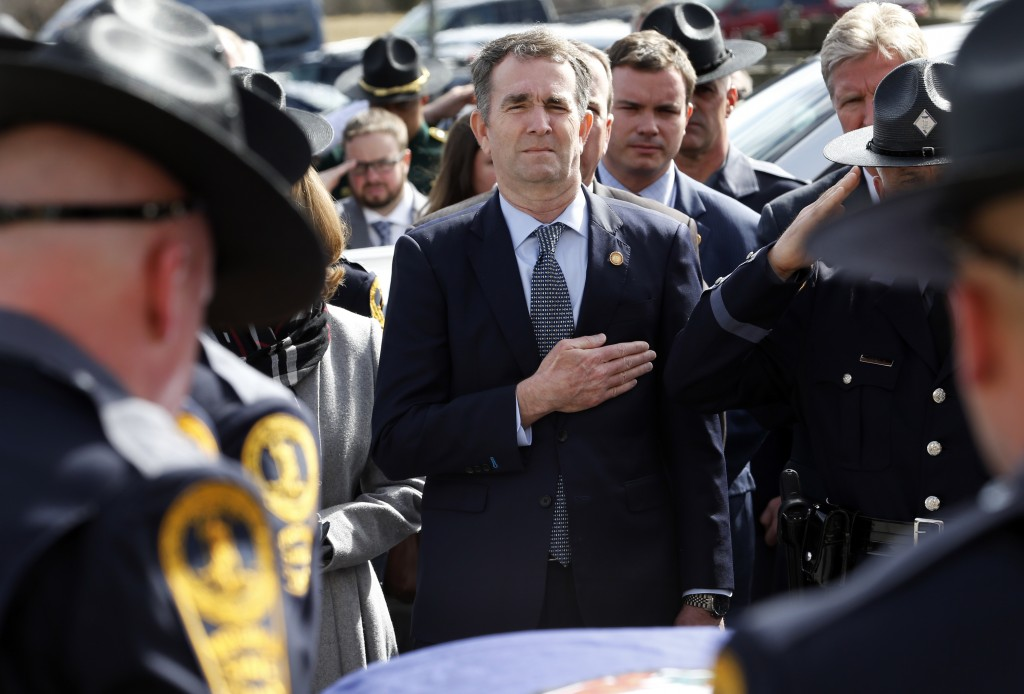 CHILHOWIE, VIRGINIA - FEBRUARY 09: Virginia Gov. Ralph Northam watches as the casket of fallen Virginia State Trooper Lucas B. Dowell is carried to a waiting tactical vehicle during the funeral at the Chilhowie Christian Church  on February 9, 2019 in Chilhowie, Virginia. (Photo by Steve Helber - Pool/Getty Images)