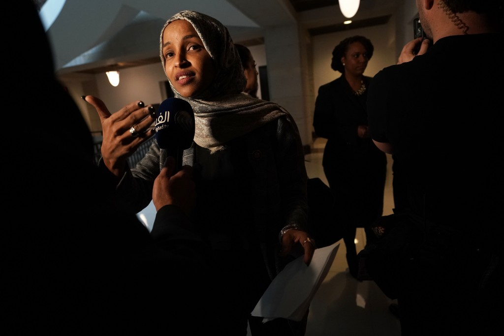 WASHINGTON, DC - JANUARY 24:   U.S. Rep. Ilhan Omar (D-MN) (L) and Rep. Ayanna Pressley (D-MA) (R) speak to members of the media after a news conference January 24, 2019 on Capitol Hill in Washington, DC. The Democratic Congresswomen held a news conference on legislation providing childcare for workers affected by the ongoing government shutdown. (Photo by Alex Wong/Getty Images)
