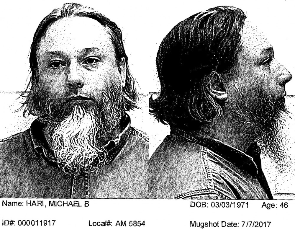 In this July 2017 booking photo released by Ford County Sheriff's Office, Michael Hari is seen on an assault charge. Hari, 47, allegedly intended for the attack to scare Muslims into leaving the U.S. He and two associates were charged Tuesday, March 13, 2018, with traveling from rural Clarence, Illinois, about 120 miles south of Chicago, to carry out the Aug. 5 pipe-bomb assault on the Dar Al-Farooq Islamic Center in Bloomington, Minnesota. (Ford County Sheriff's Office via The News-Gazette, via AP)