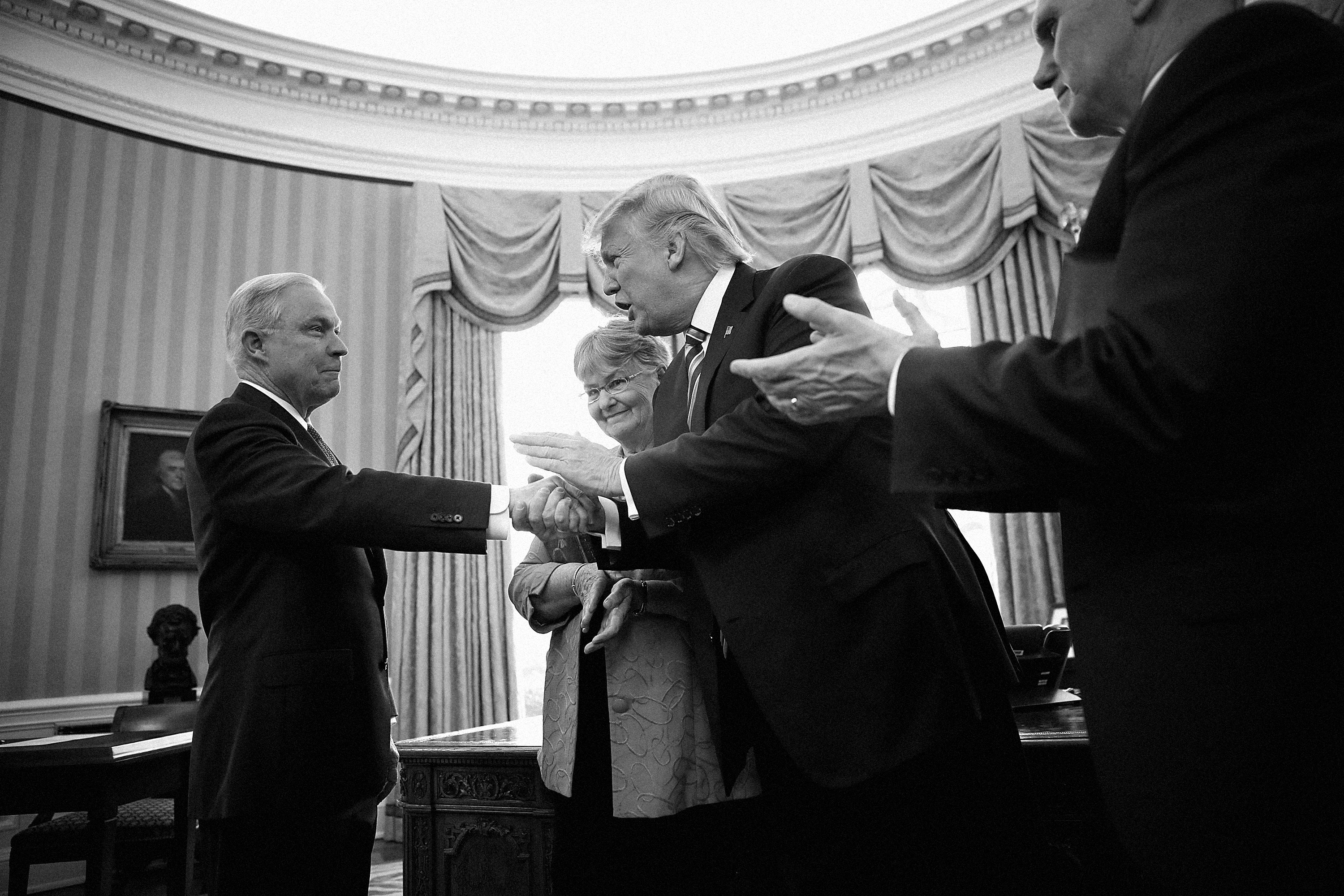 WASHINGTON, DC - FEBRUARY 09:  U.S. President Donald Trump (2nd R) shakes the hand of Jeff Sessions after Sessions was sworn in as the new U.S. Attorney General by U.S. Vice President Mike Pence (R) in the Oval Office of the White House February 9, 2017 in Washington, DC. Trump also signed three executive orders immediately after the swearing in ceremony. Also pictured is Sessions's wife, Mary (2nd L), holding the bible.