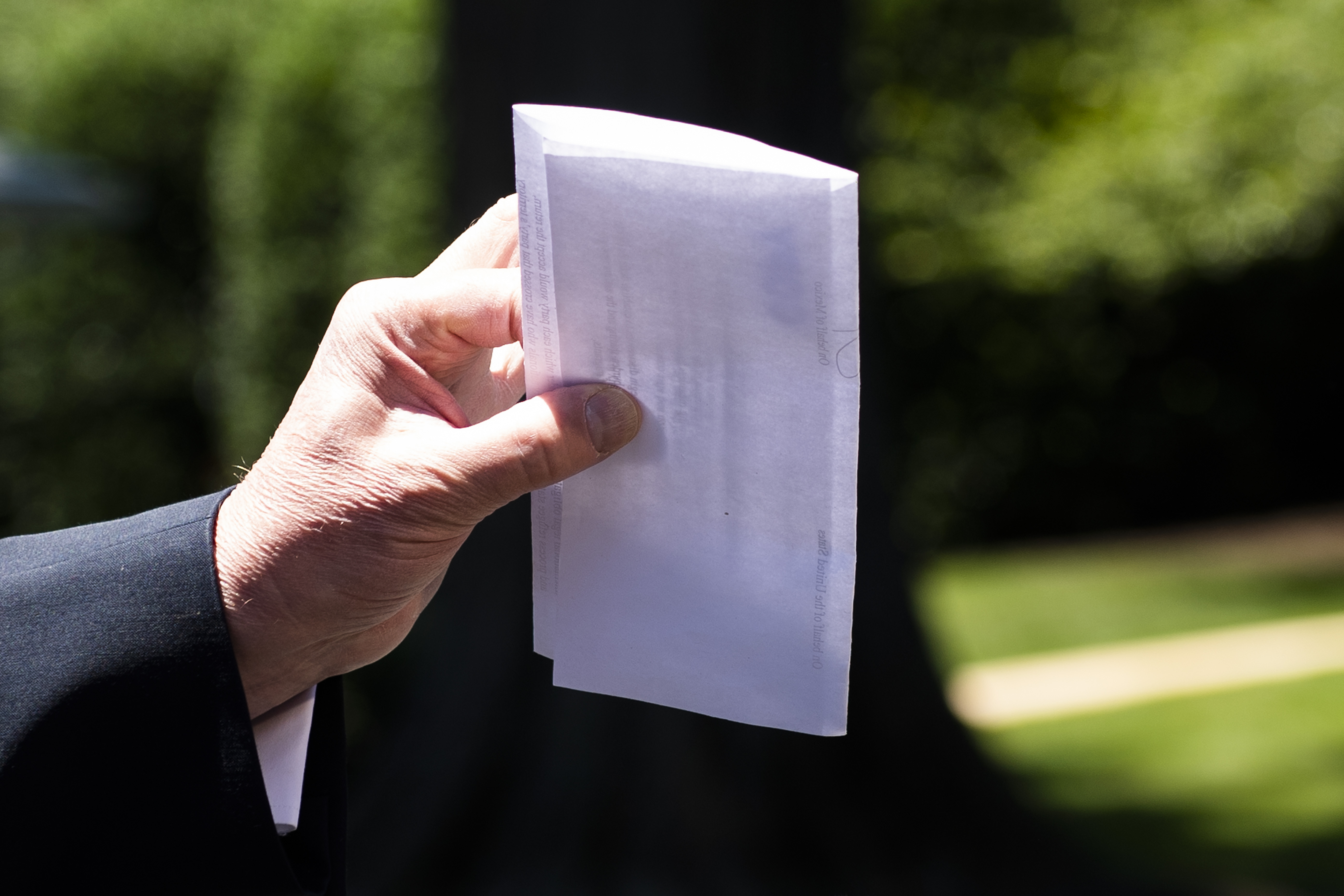 US President Donald Trump holds piece of paper saying its his deal with Mexico as he speaks with reporters at the White House, in Washington, DC, on June 11, 2019. - Trump did not show the paper to reporters.