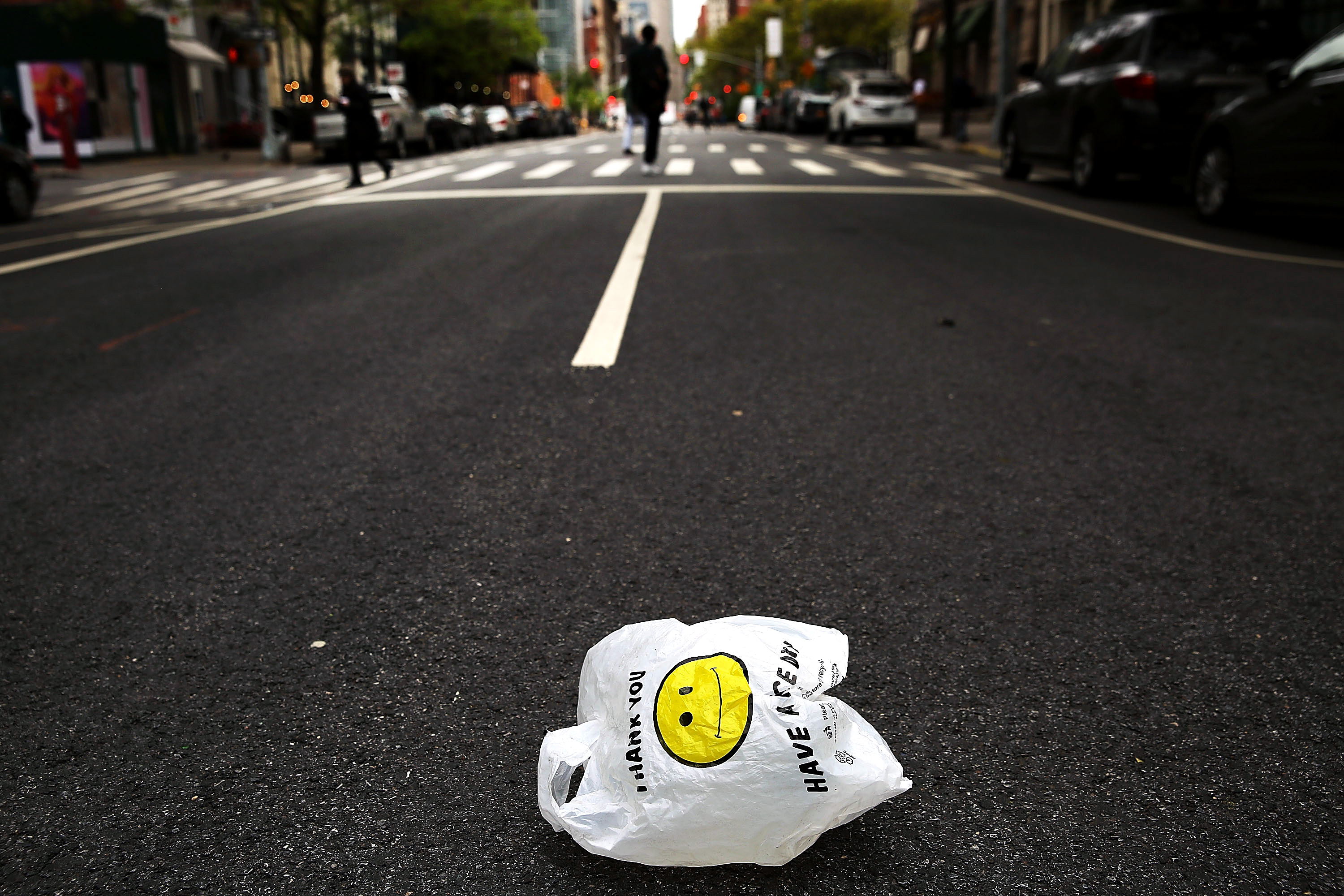 A plastic bag sits in a Manhattan street on May 05, 2016 in New York City.New York's City Council is scheduled to vote Thursday on a bill that would require most stores to charge five cents per bag in an effort to cut down on plastic waste. New York's sanitation department estimates that every year 10 billion bags are thrown in the trash. (Photo by Spencer Platt/Getty Images)