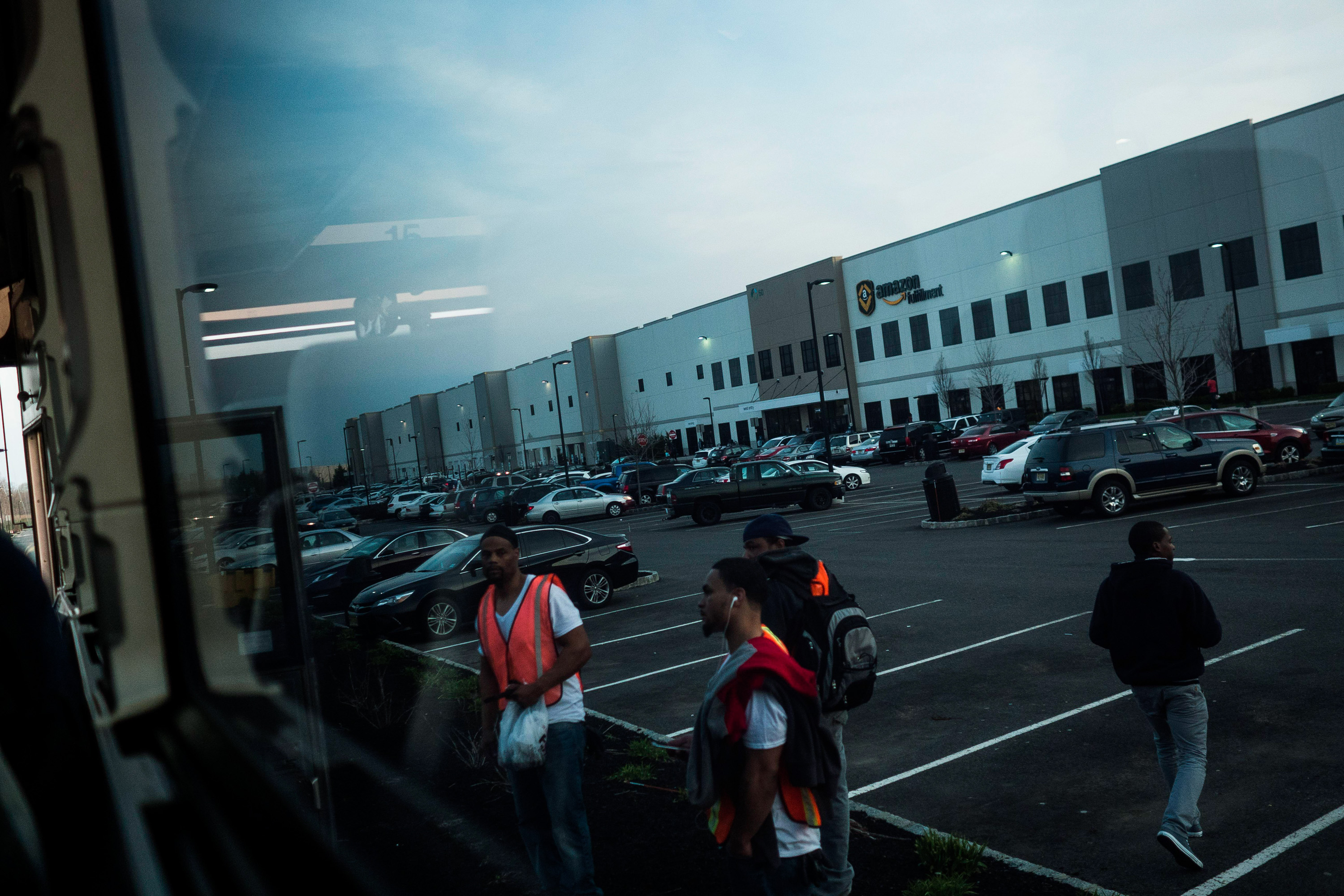 -- PHOTO MOVED IN ADVANCE AND NOT FOR USE - ONLINE OR IN PRINT - BEFORE APRIL 16, 2017. -- Commuters use a shuttle bus at the Amazon Center in Robbinsville, N.J., April 12, 2017. For all the attention and urgency that online shopping attracts, the vast majority of purchases are still made in-person, in places like Kmart, before a checkout counter, purse or wallet in hand. (John Taggart/The New York Times)