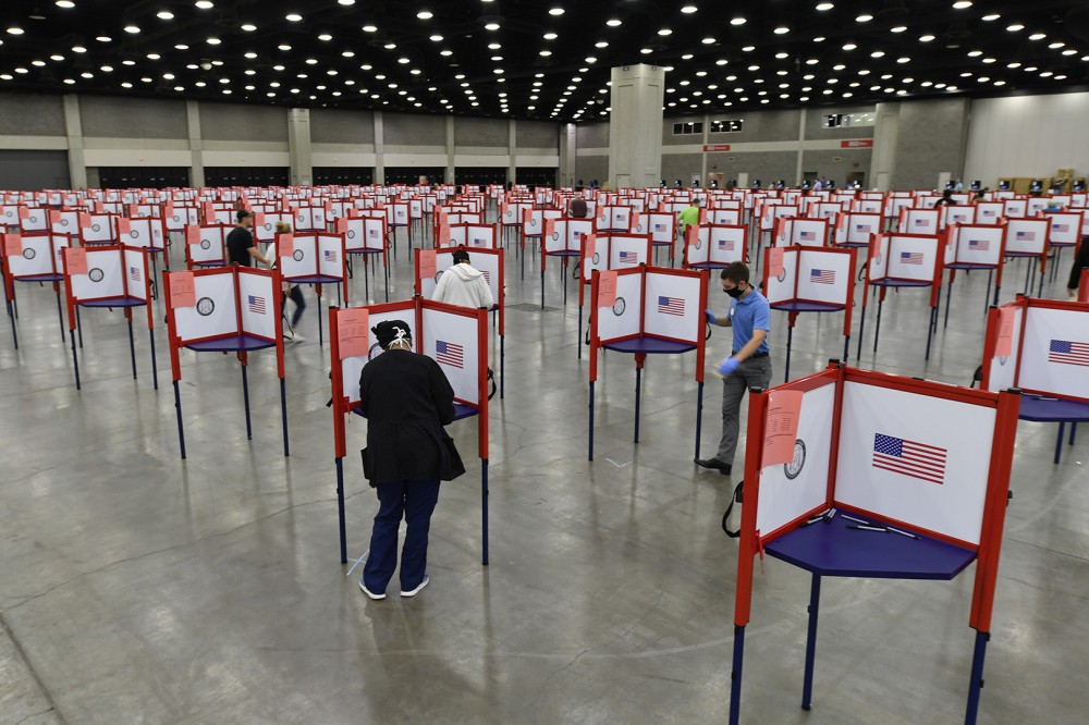 """FILE - In this June 23, 2020, file photo voting stations are set up in the South Wing of the Kentucky Exposition Center for voters to cast their ballot in the Kentucky primary in Louisville, Ky. Just over four months before Election Day, President Donald Trump is escalating his efforts to delegitimize the upcoming presidential election. Last week he made a startling, and unfounded, claim that 2020 will be """"the most corrupt election in the history of our country."""" (AP Photo/Timothy D. Easley, File)"""