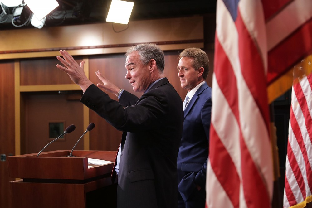 Sen. Tim Kaine (D-VA) (L) and Sen. Jeff Flake (R-AZ) talk about their introduction of a new Authorization for the Use of Military Force (AUMF) against the Islamic State of Iraq and Syria (ISIS), al-Qaeda and the Taliban during a news conference at the U.S. Capitol May 25, 2017 in Washington, DC. The new AUMF would repeal and replace Congress' 2001 and 2002 authorizations while expanding the list of terrorist organizations that the U.S. can take military action against.  (Photo by Chip Somodevilla/Getty Images)