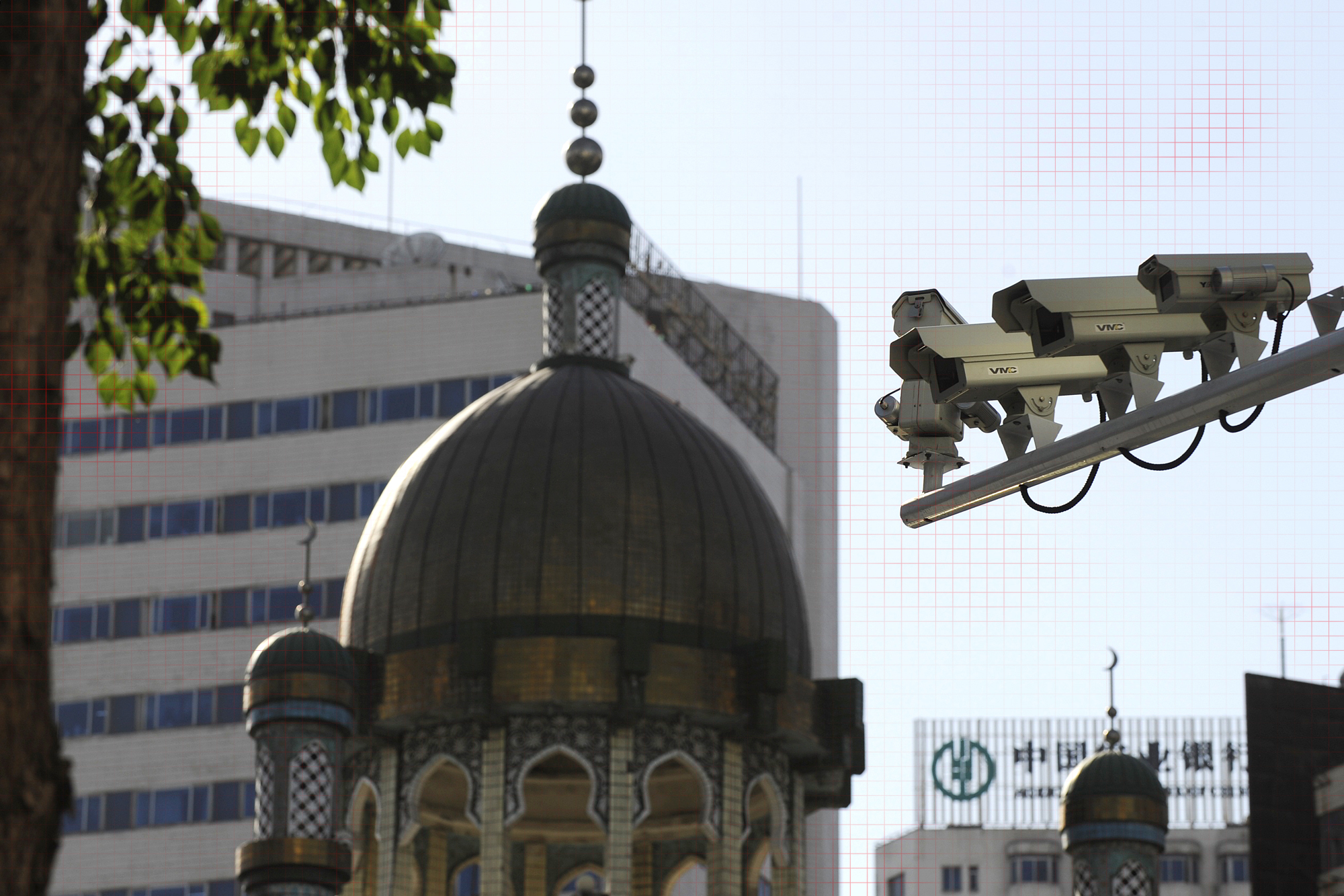 Security cameras are seen (R) on a street in Urumqi, capital of China's Xinjiang region on July 2, 2010.